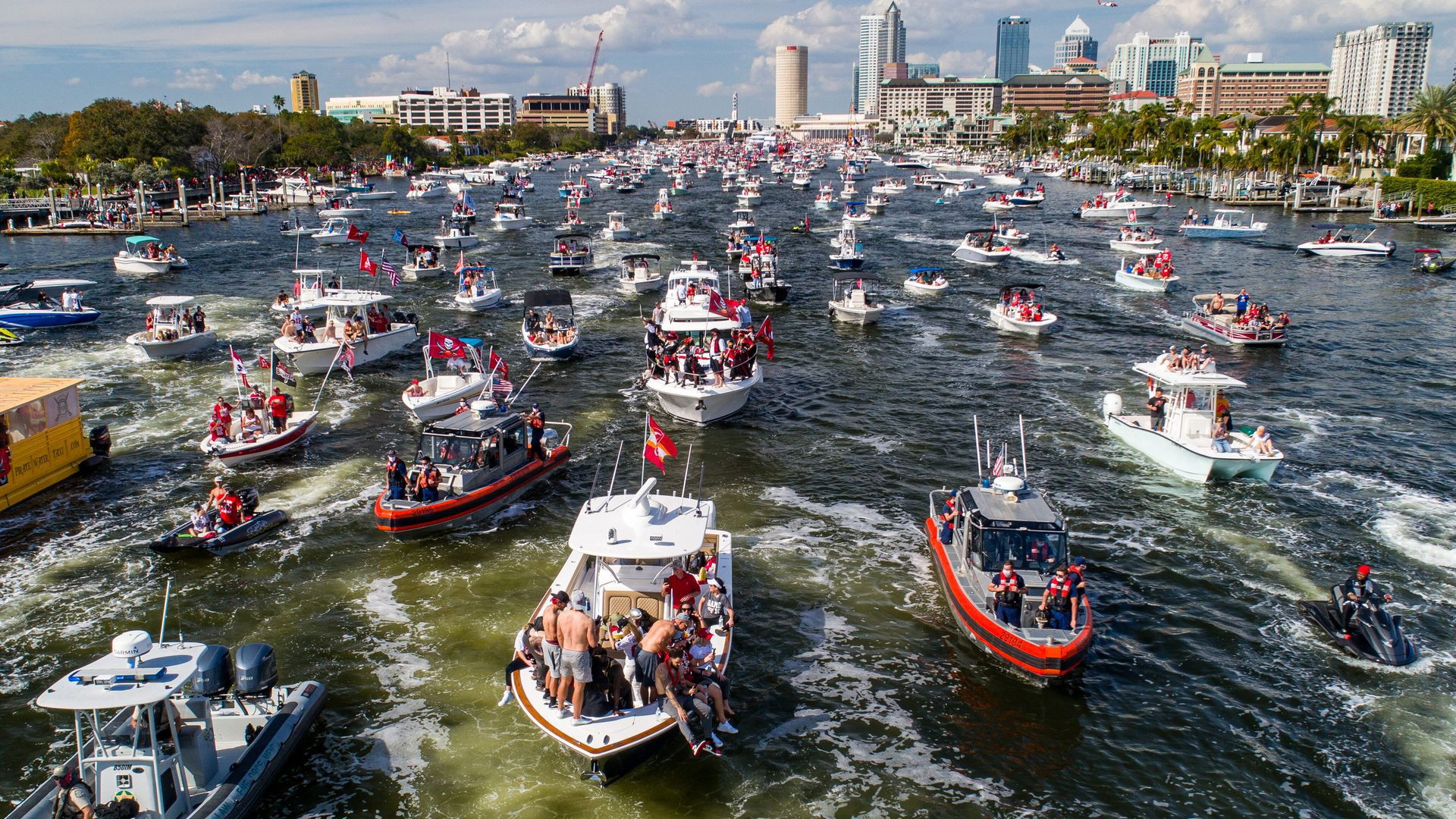 Picture of Super Bowl Victory Boat Parade, with multiple boats on the river