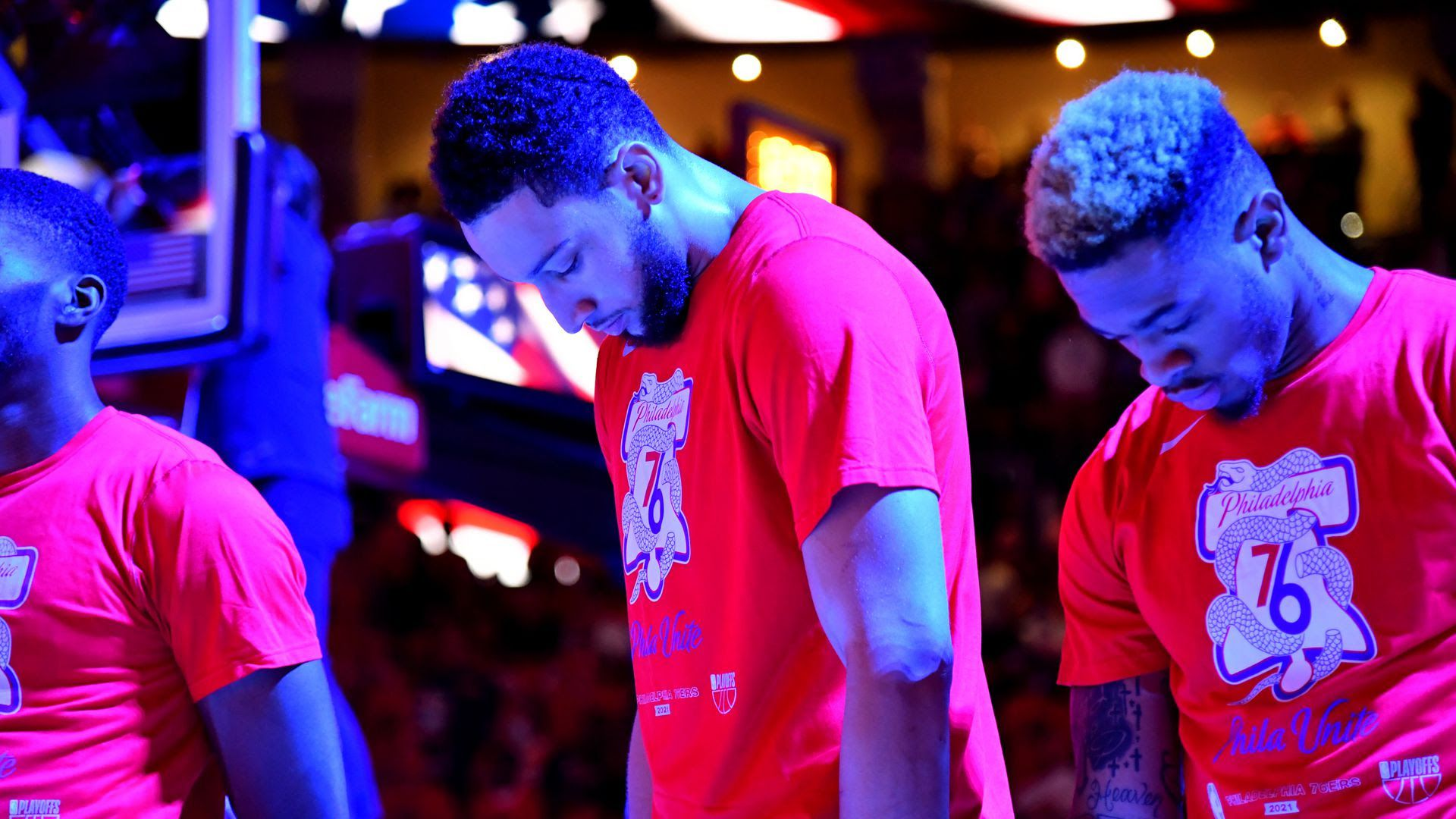 Ben Simmons bows his head on the court.