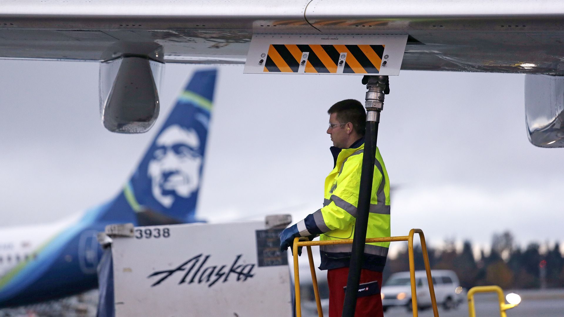 Fueling manager Jarid Svraka looks on as he fuels an Alaska Airlines Boeing 737-800 jet with a new, blended alternative jet fuel.
