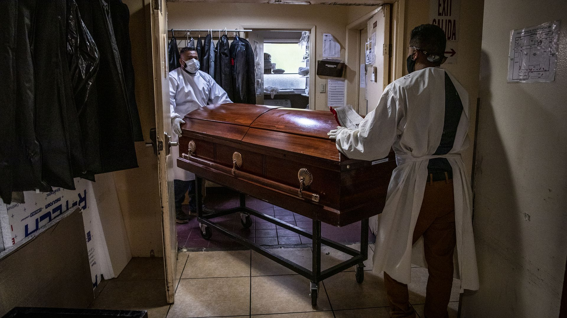 Continental Funeral Home attendants move a casket