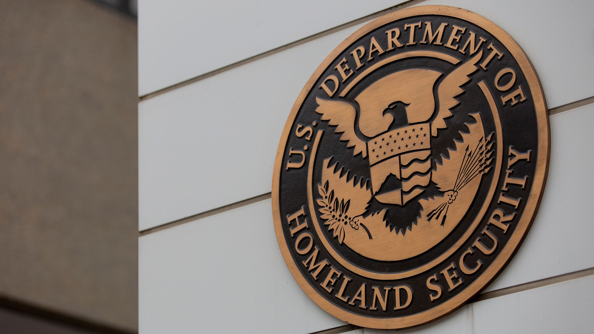The seal of the Department of Homeland Security on a building.