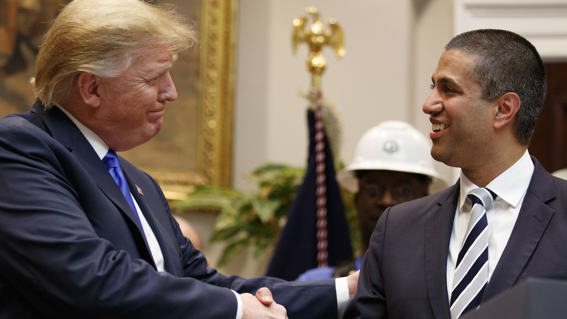 Photo of President Trump shaking hands with FCC chairman Ajit Pai