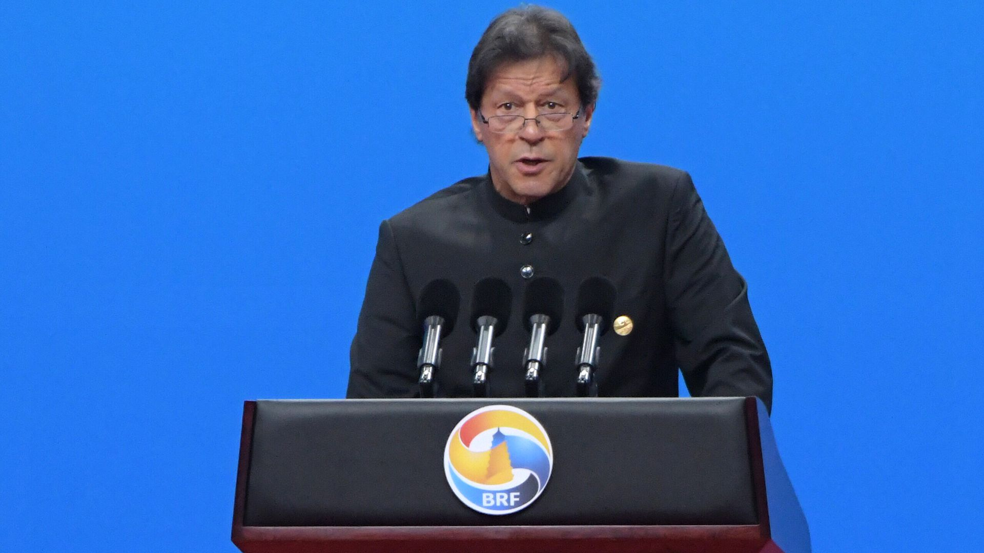 Imran Khan speaking at a lectern