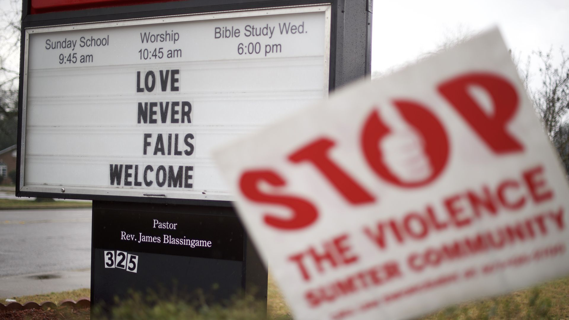 "A sign outside a Baptist church says, ""Love never fails. Welcome."""