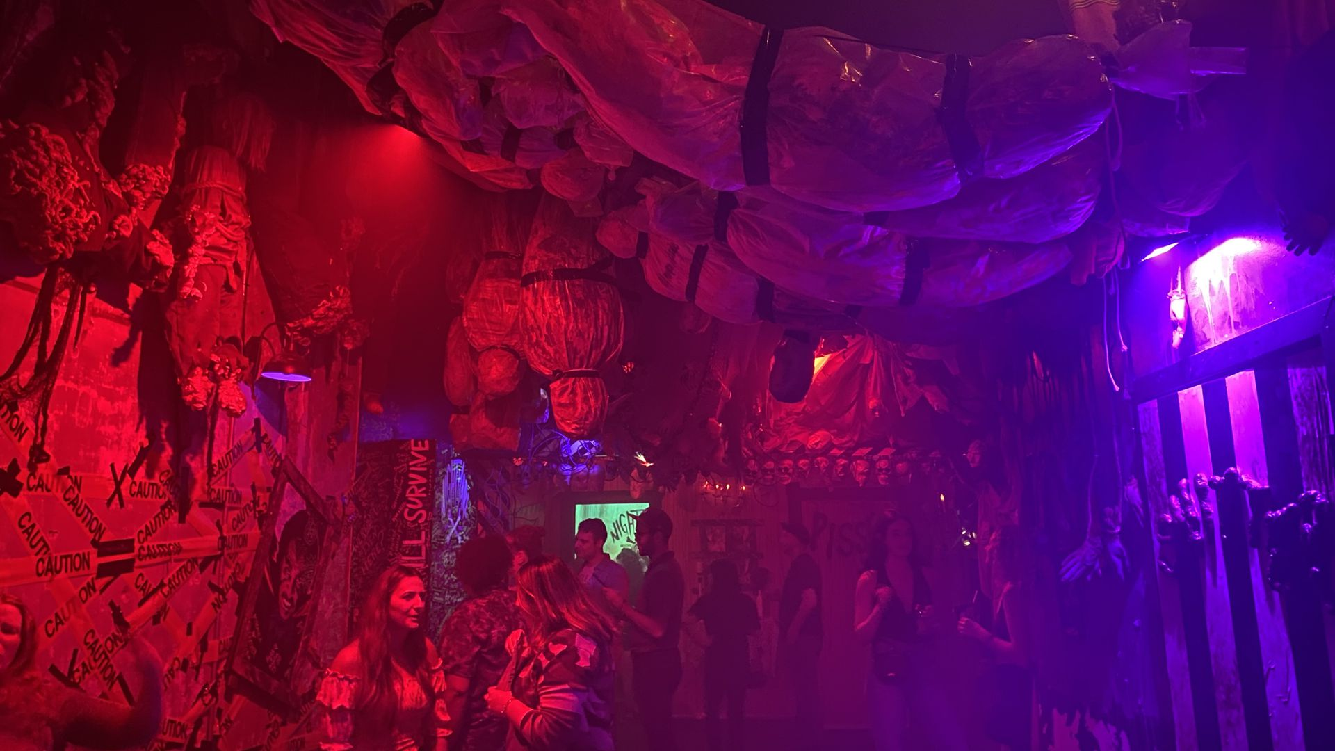 Patrons milling around the inside of the Nightmare Before Tinsel. Photo: Taylor Allen/Axios