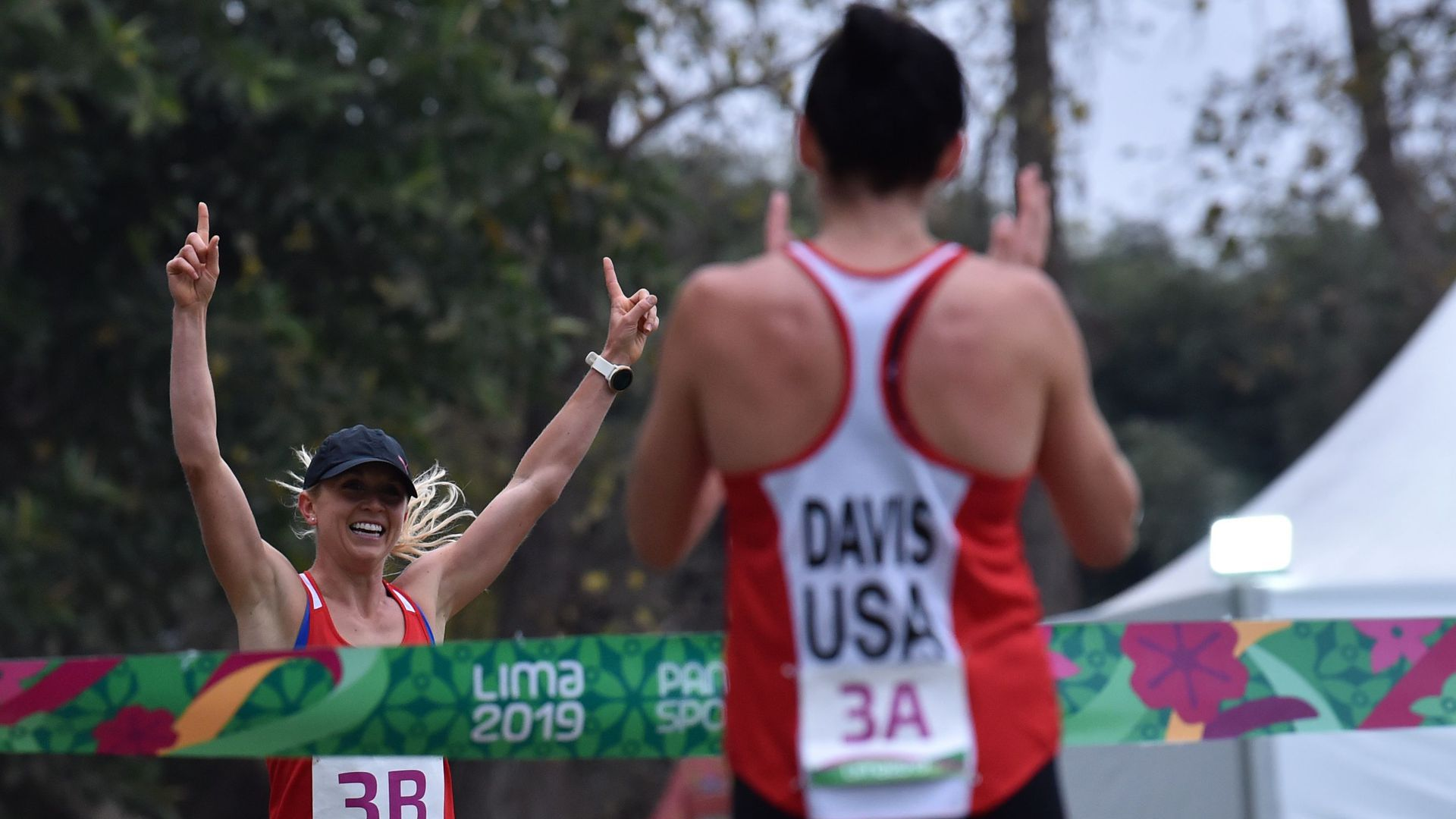 Samantha Schultz raises her hands in triumph