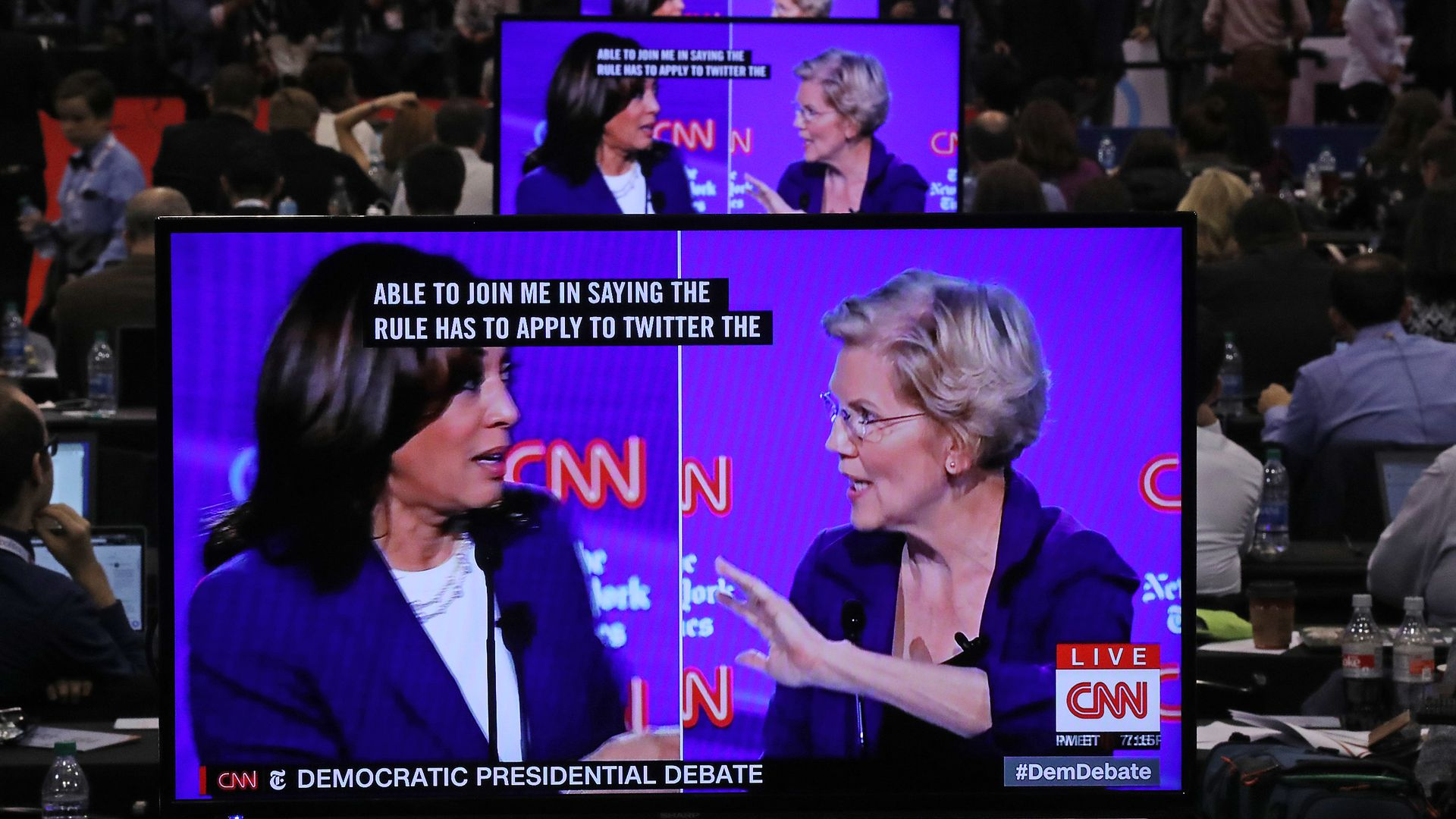 Photo of Sens. Kamala Harris and Elizabeth Warren debating on a screen