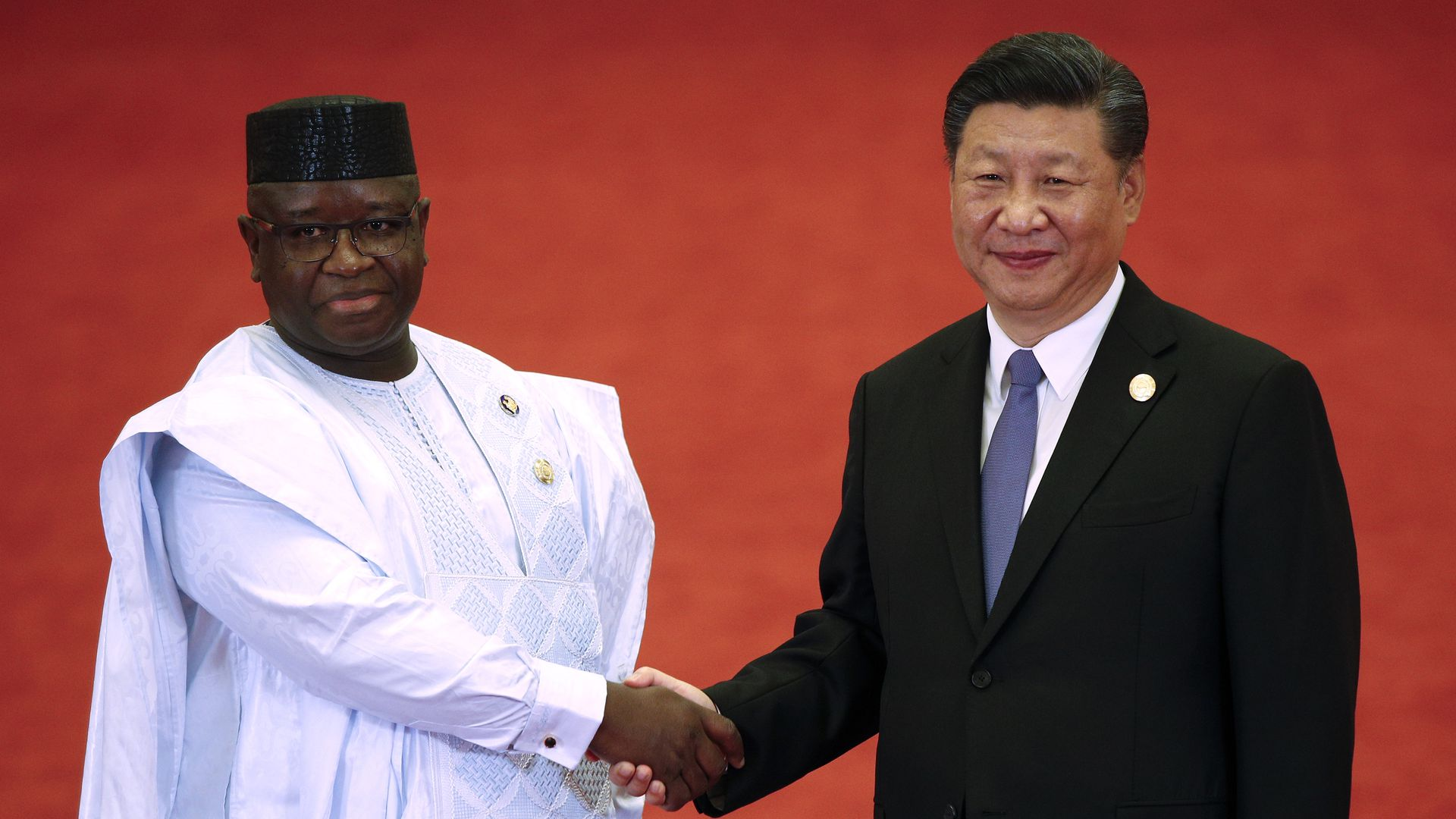 Sierra Leone President Julius Maada Bio shakes hands with Chinese President Xi Jinping during the Forum on China-Africa Cooperation on September 3, 2018 in Beijing, China.