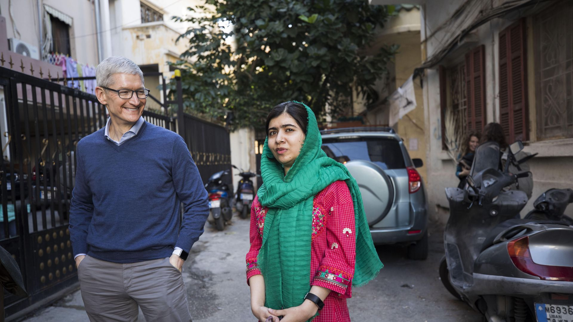 Tim Cook and Malala Yousafzai outside the home of a family with daughters attending school in Beirut supported by the Malala Fund