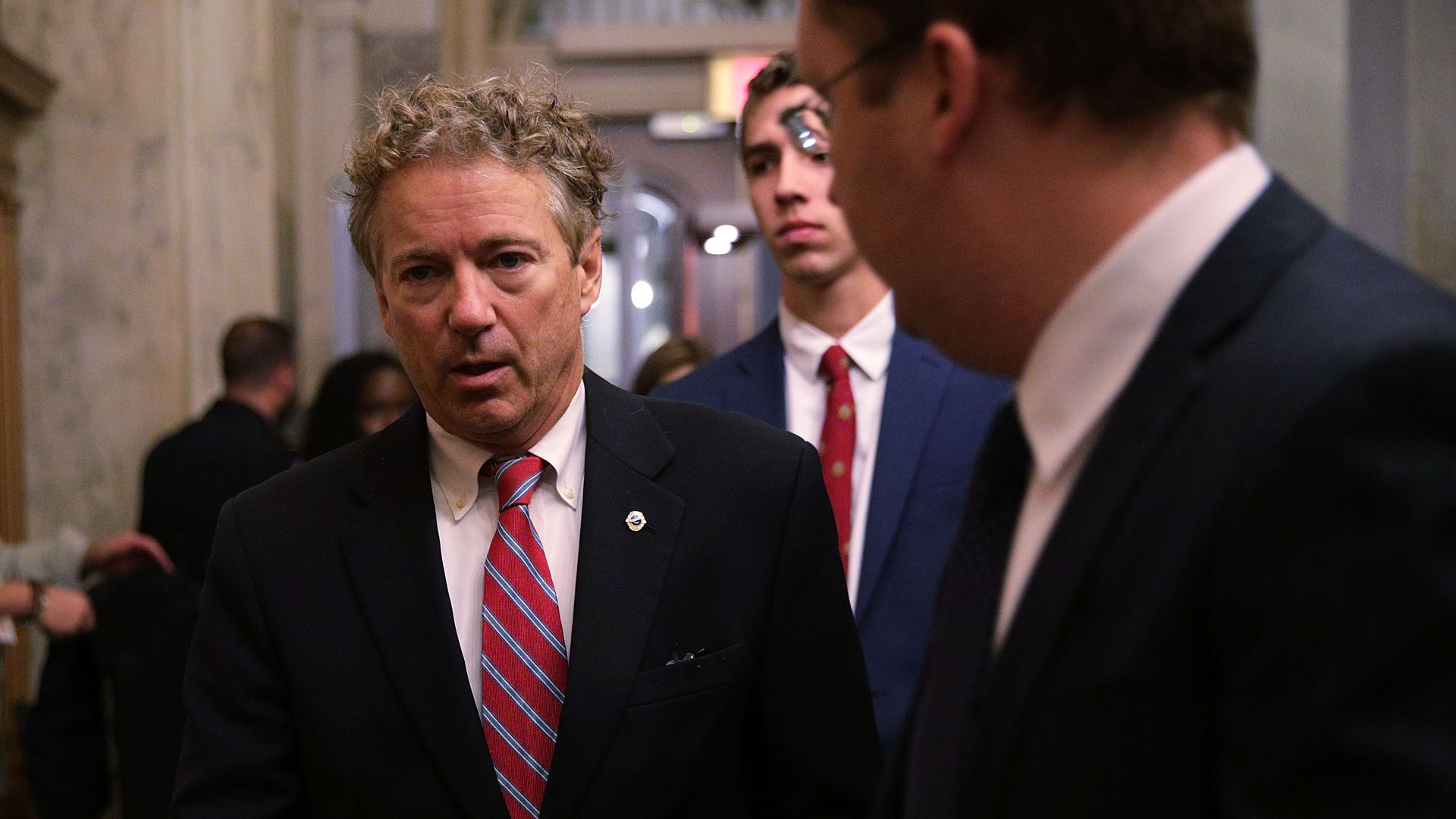 Rand Paul in suit and red tie.