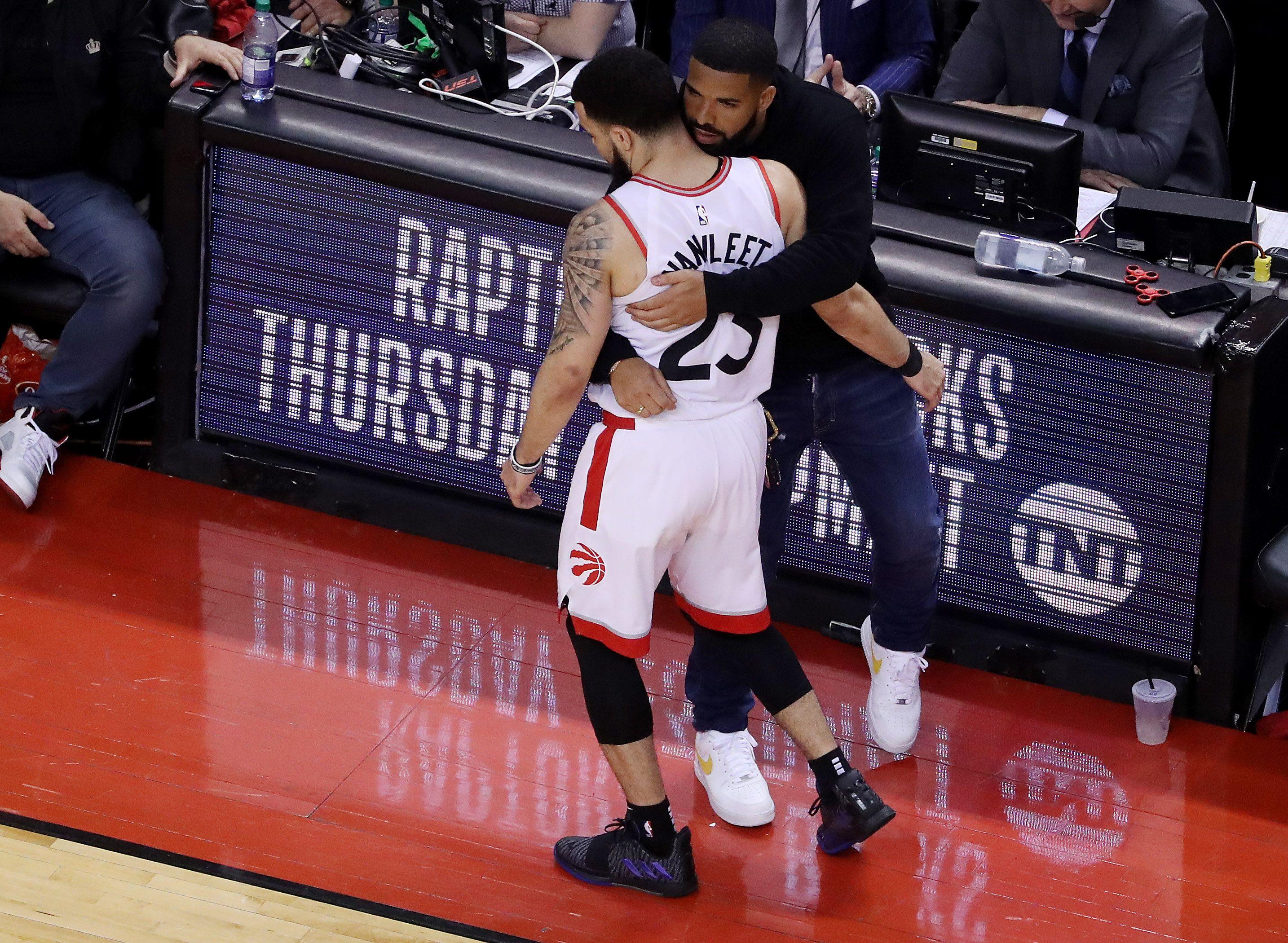 Drake hugs Fred Van Vleet