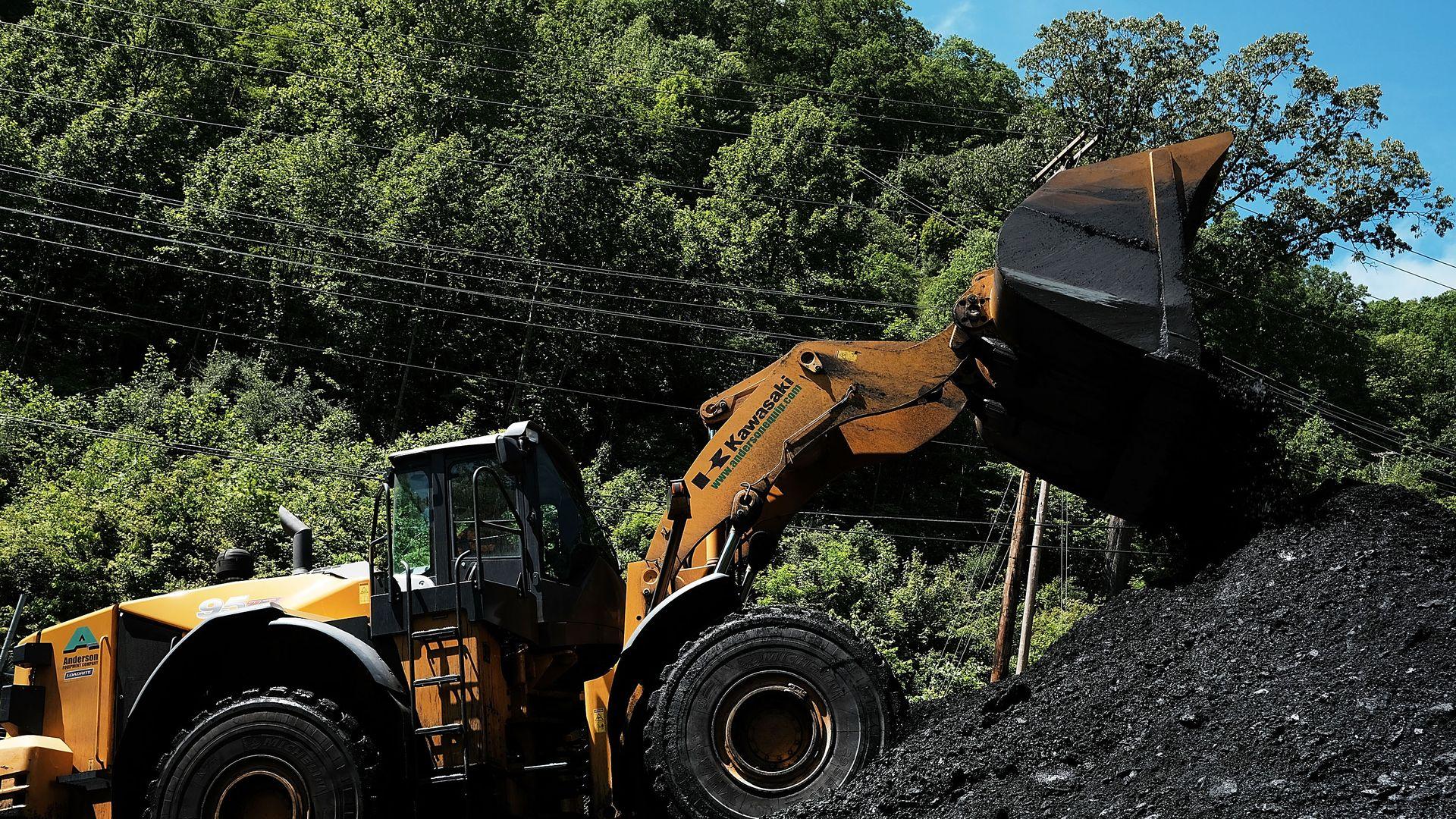 A tractor at a coal plant