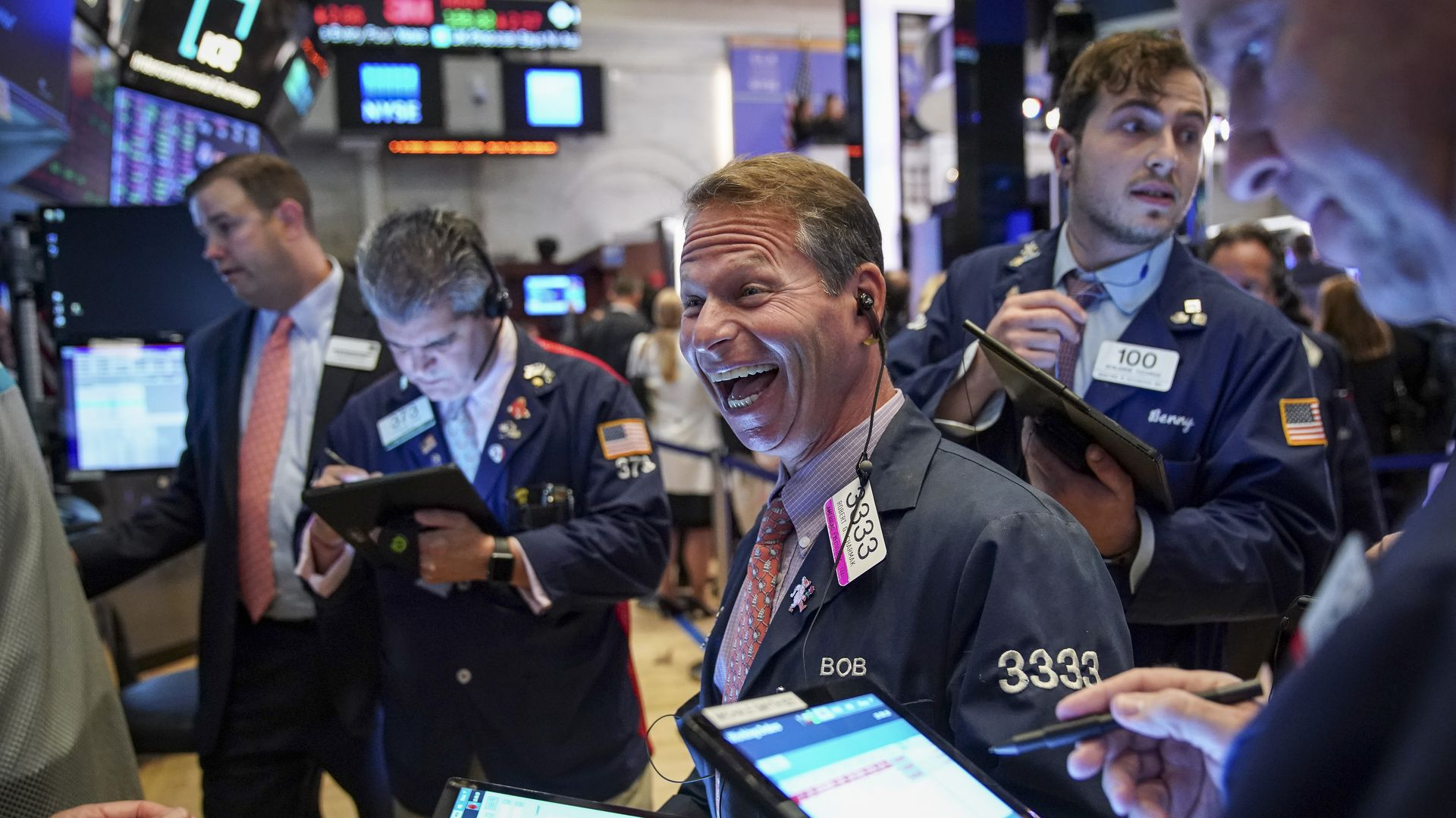 Traders look at screens on the floor of the New York Stock Exchange.