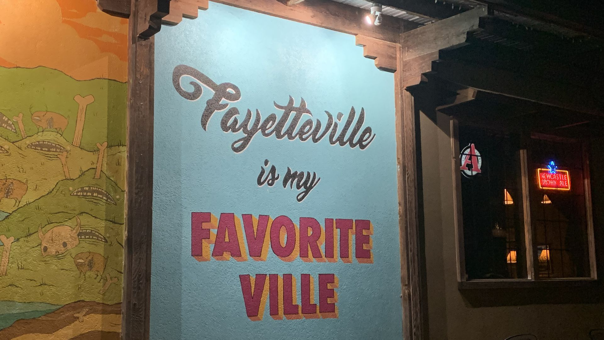 A sign that reads Fayetteville is my favorite ville