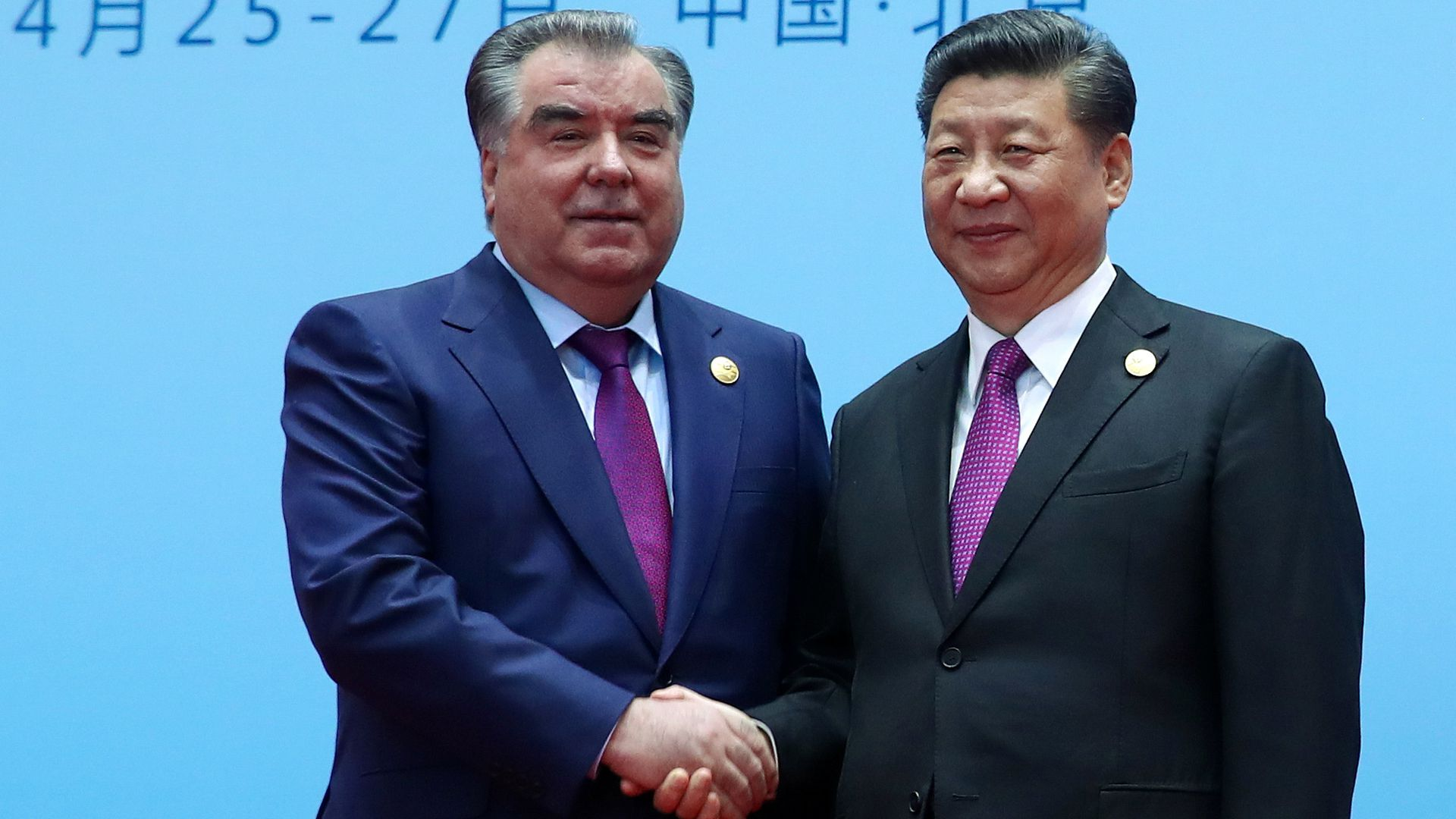 Xi Jinping and Emomali Rahmon shaking hands