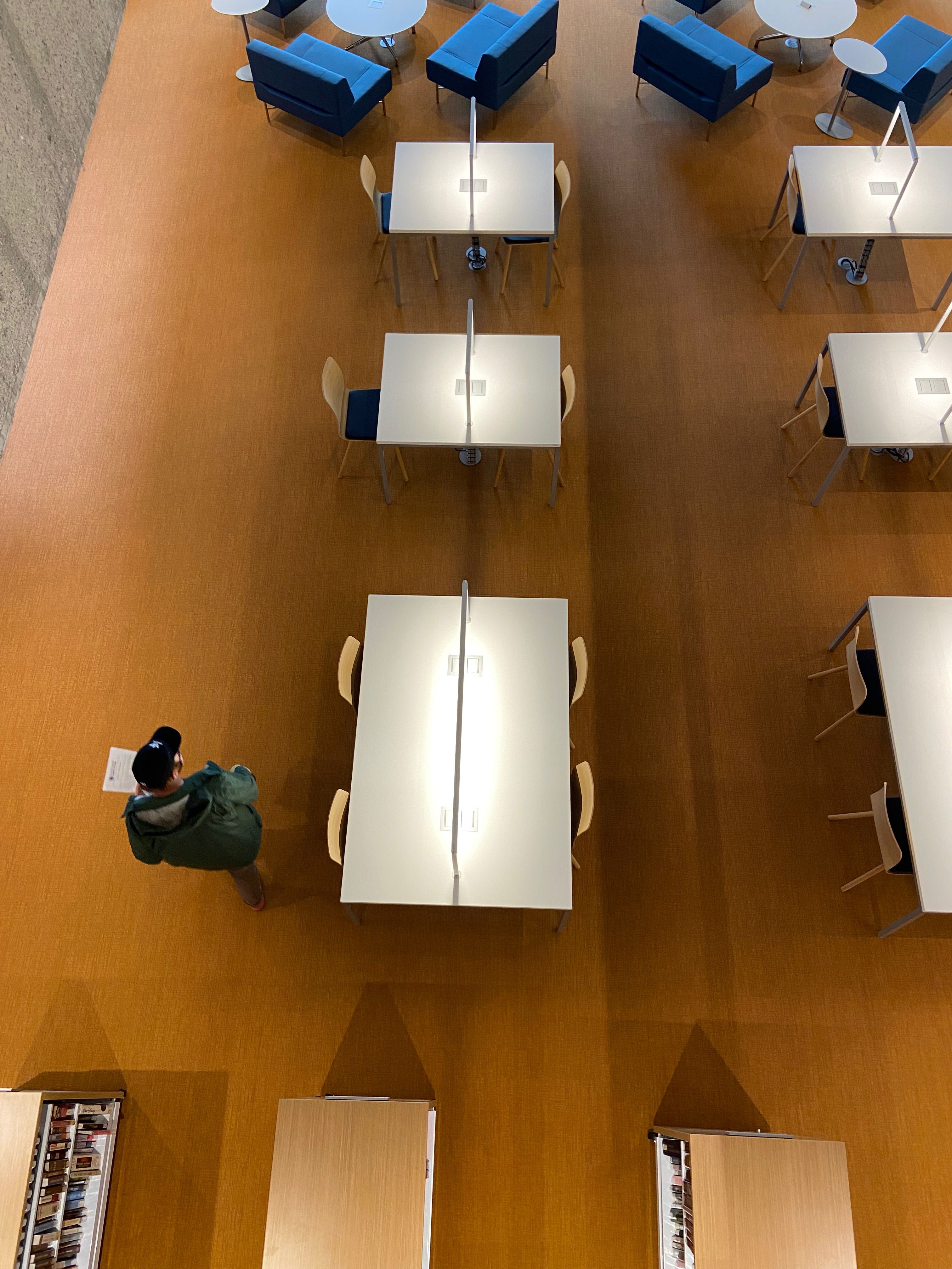 A man walks past new desks in the renovated Central Library in Downtown Atlanta
