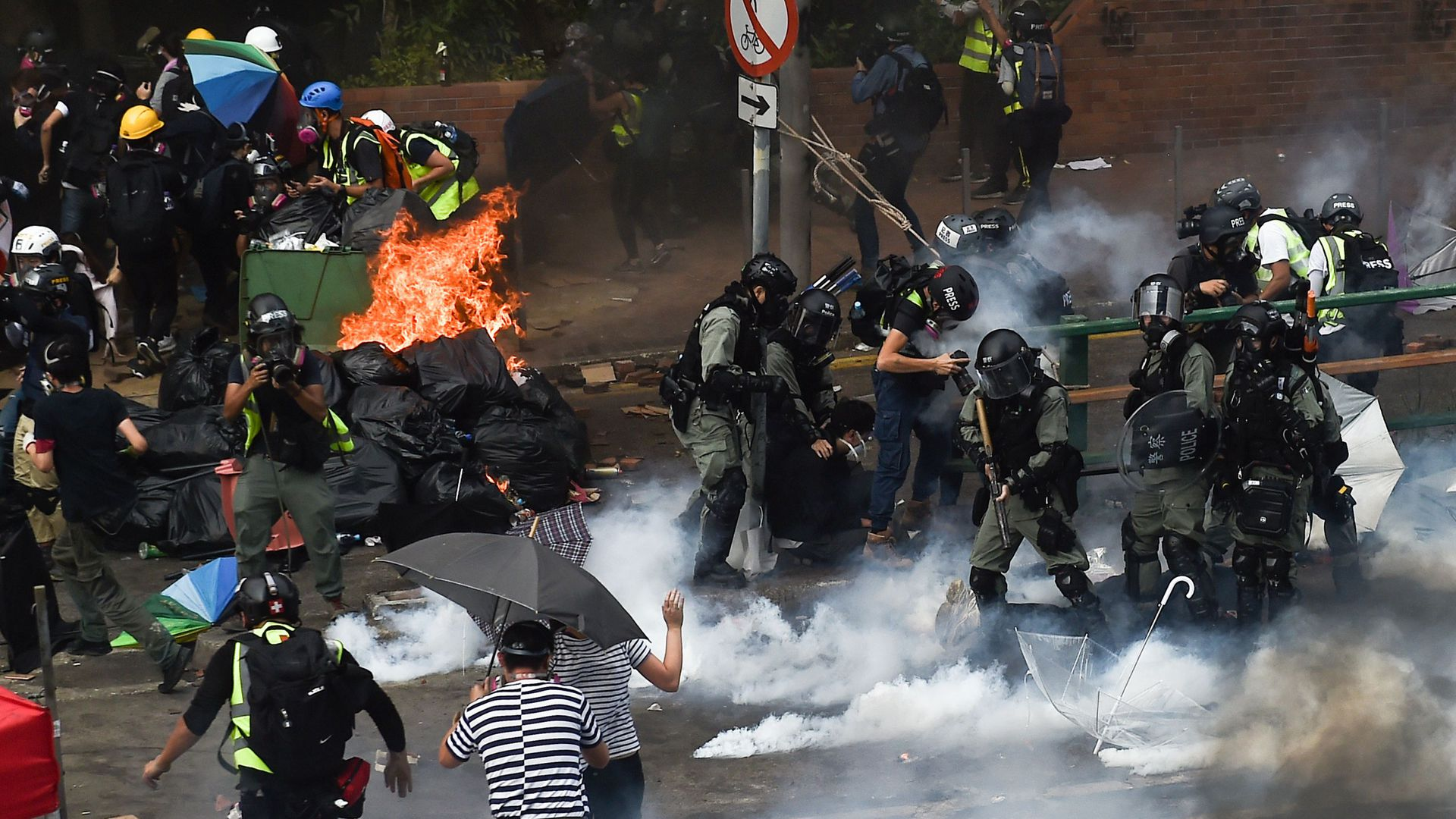 Riot police and protesters clash in the Hung Hom district of Hong Kong on Monday