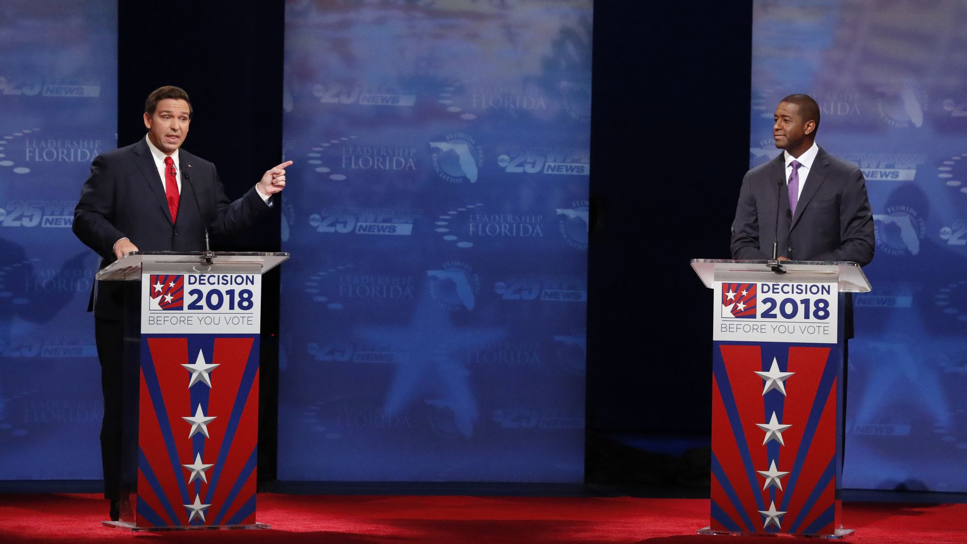 Ron DeSantis and Andrew Gillum on a debate stage.