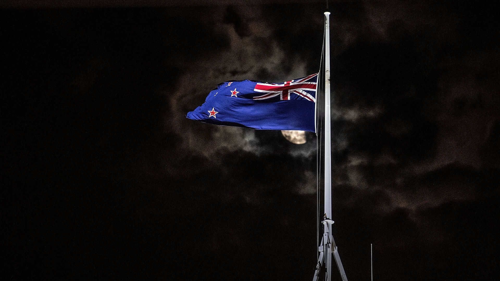The New Zealand national flag is flown at half-mast on a Parliament building in Wellington on March 15, 2019, after a shooting incident in Christchurch.