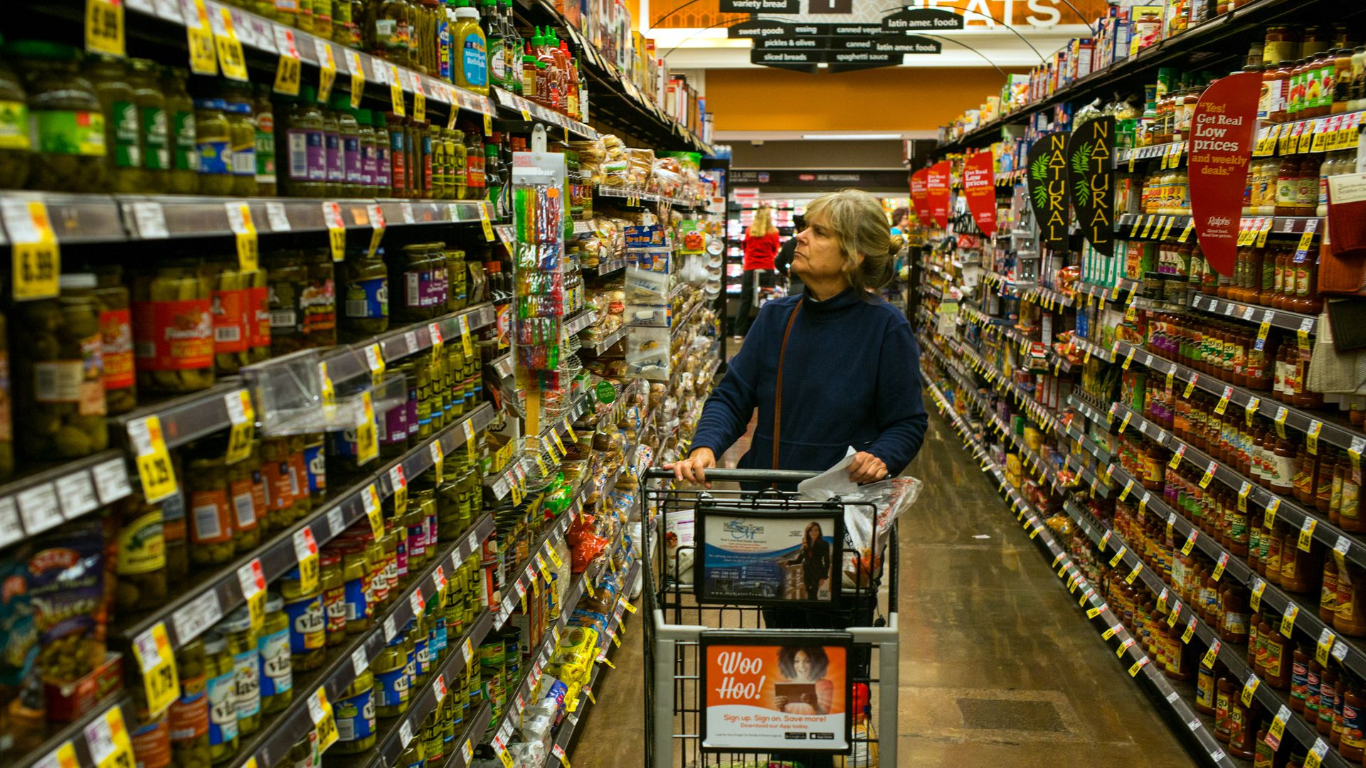 A woman browses products in an aisle