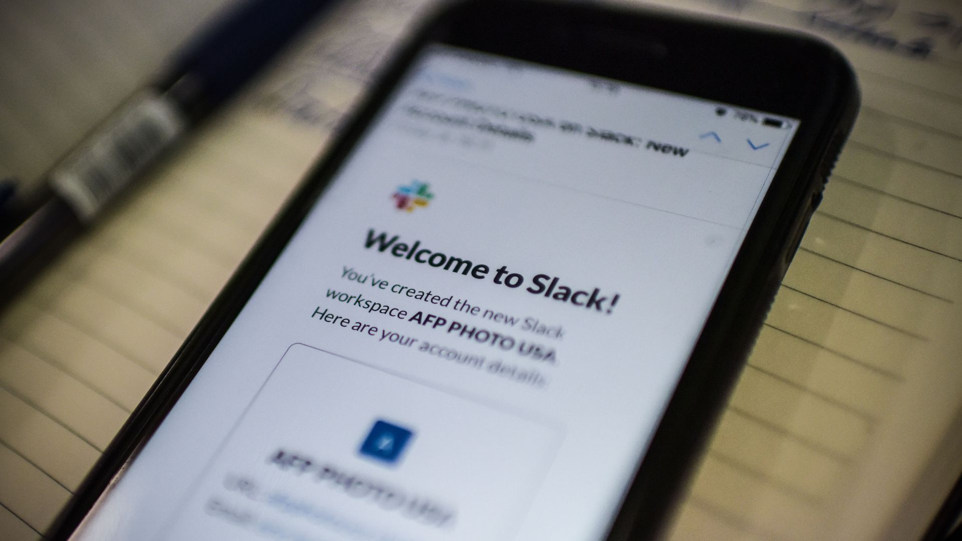 An image of a phone logging into messaging app Slack.