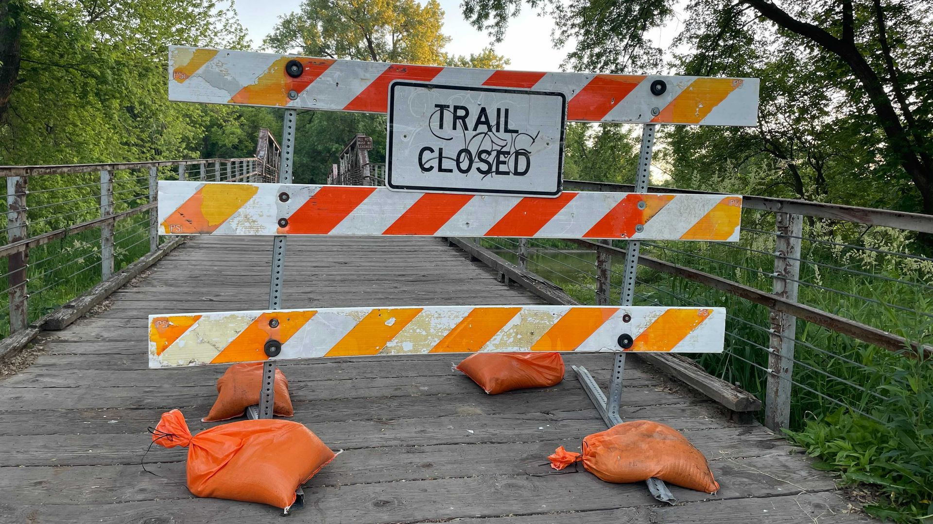 Trail closed sign by Des Moines Water Works.