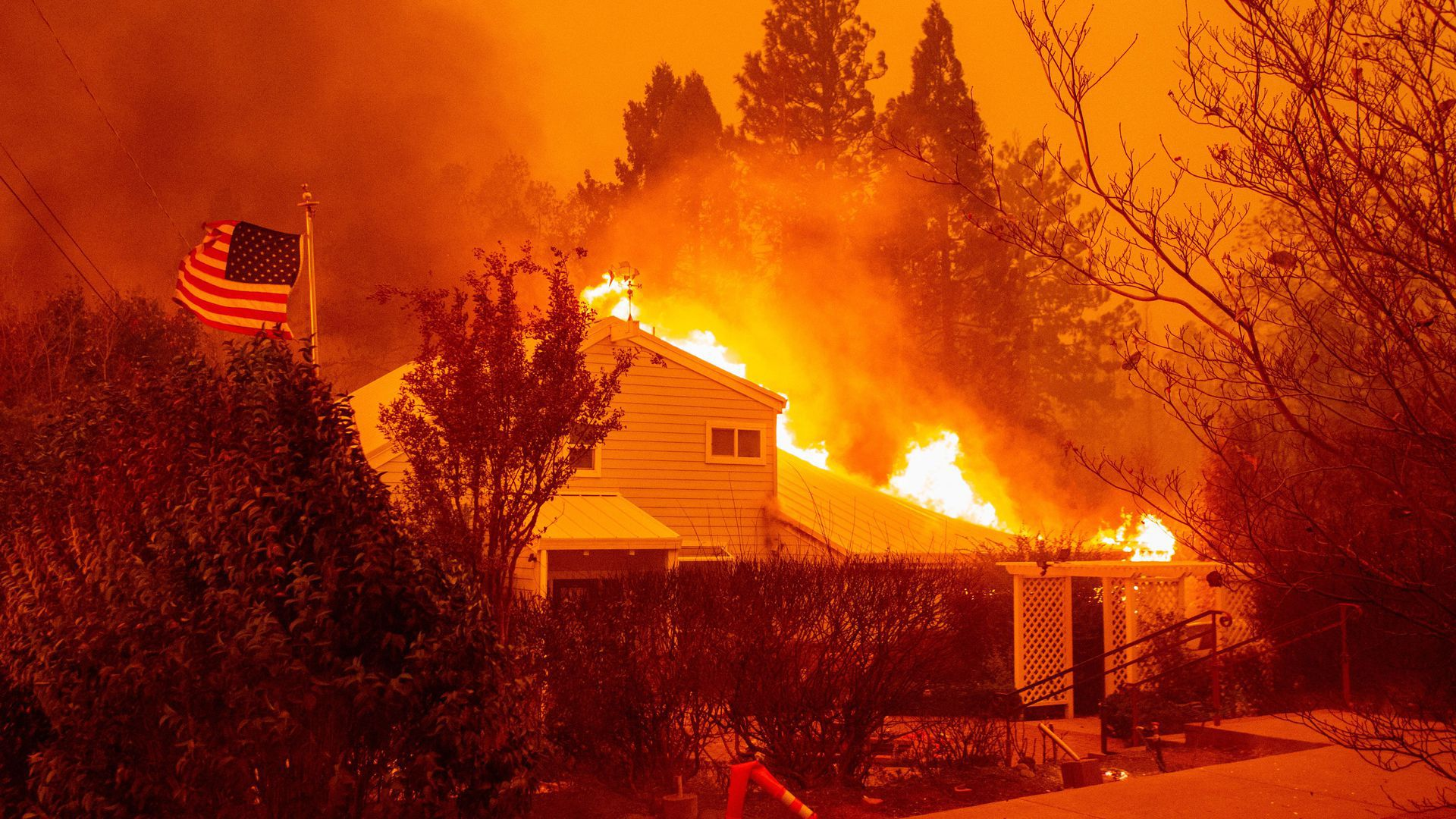 A house burns during the Camp fire in Paradise, California