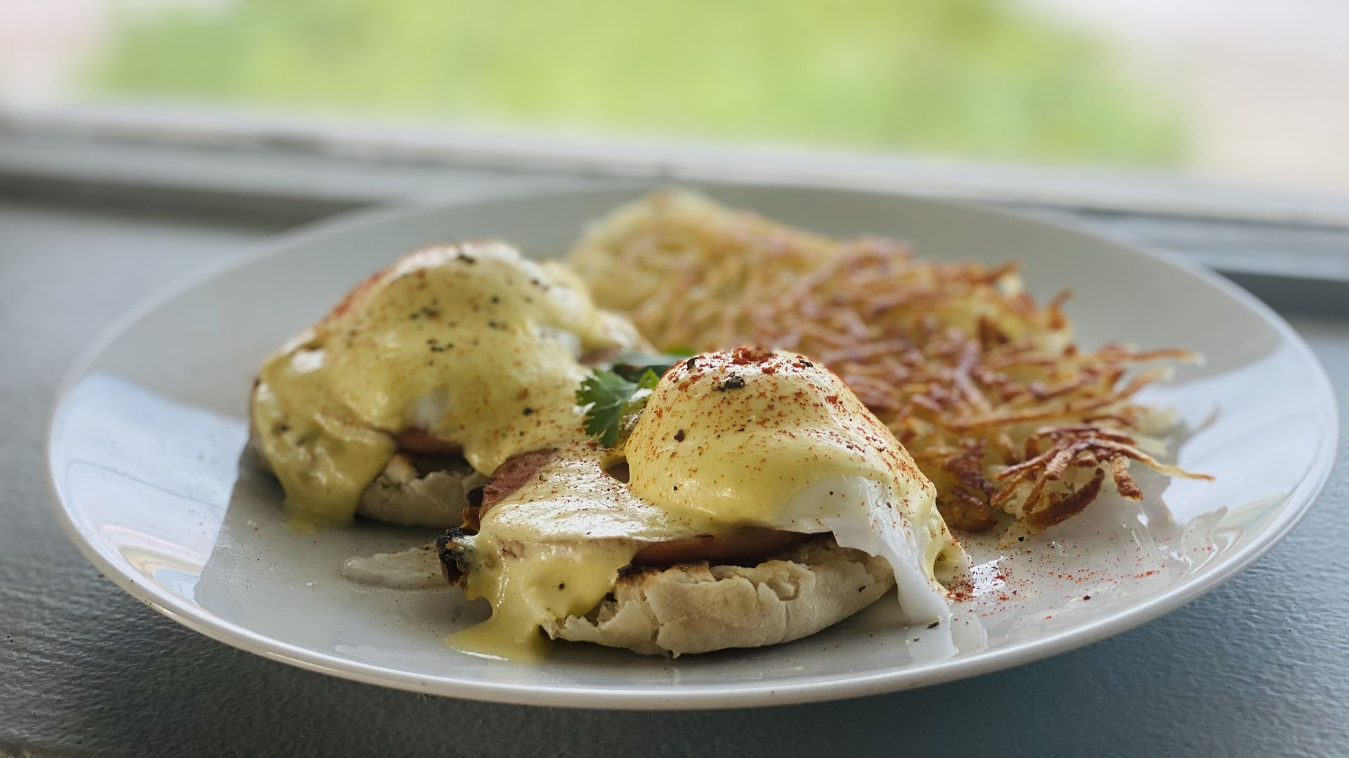 A photo of eggs Benedict with latkes.