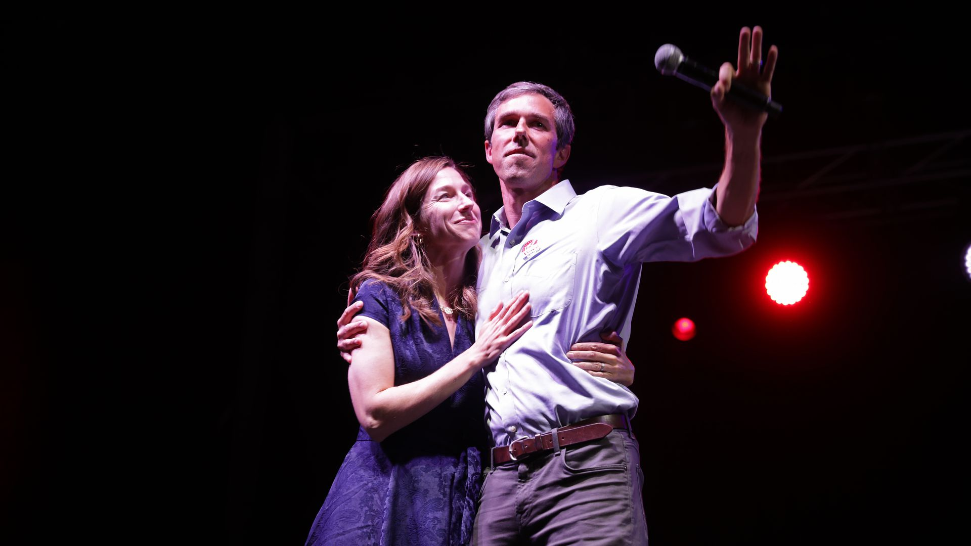 Beto O'Rourke and wife Amy Sanders arrive onstage at Southwest University Park November 06, 2018 in El Paso, Texas.