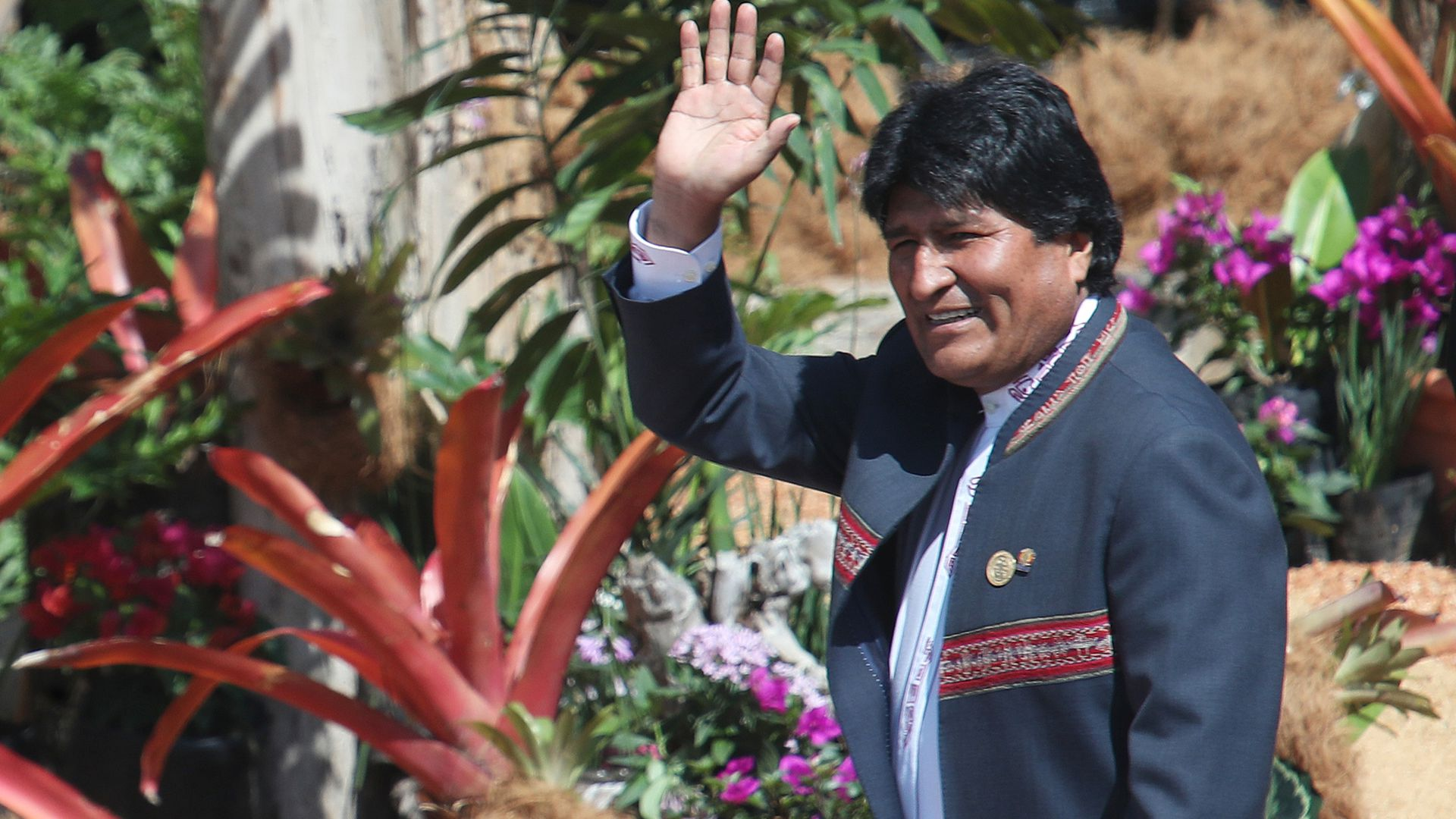 Bolivia's election mystery: Vote tallies stop with Morales facing runoff
