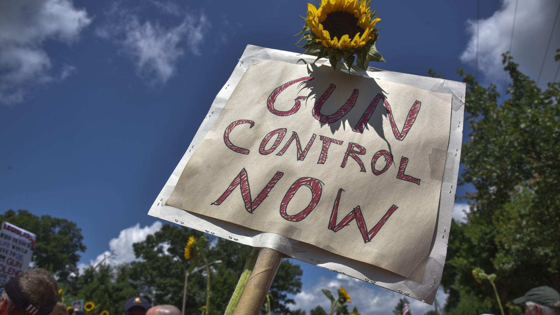 A gun control now sign