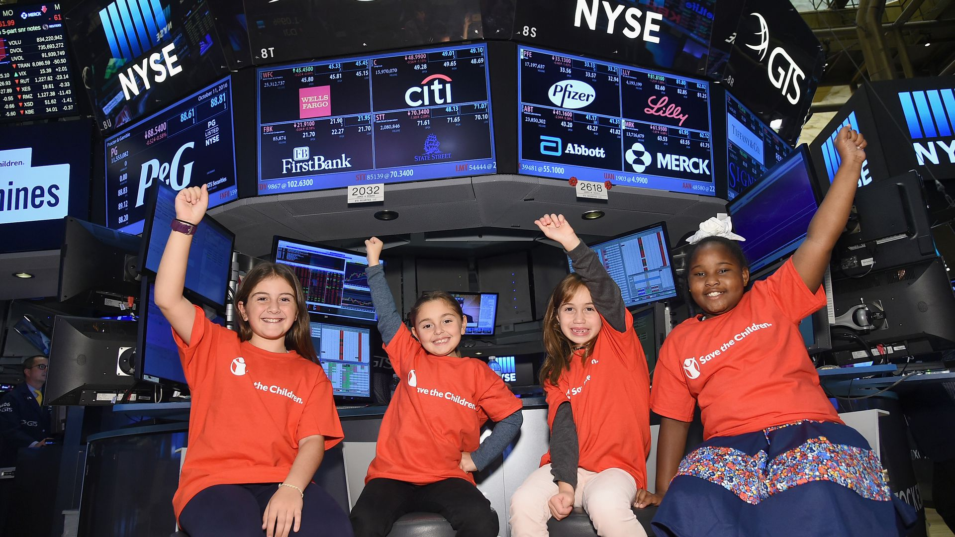 Save the Children girls at the stock market