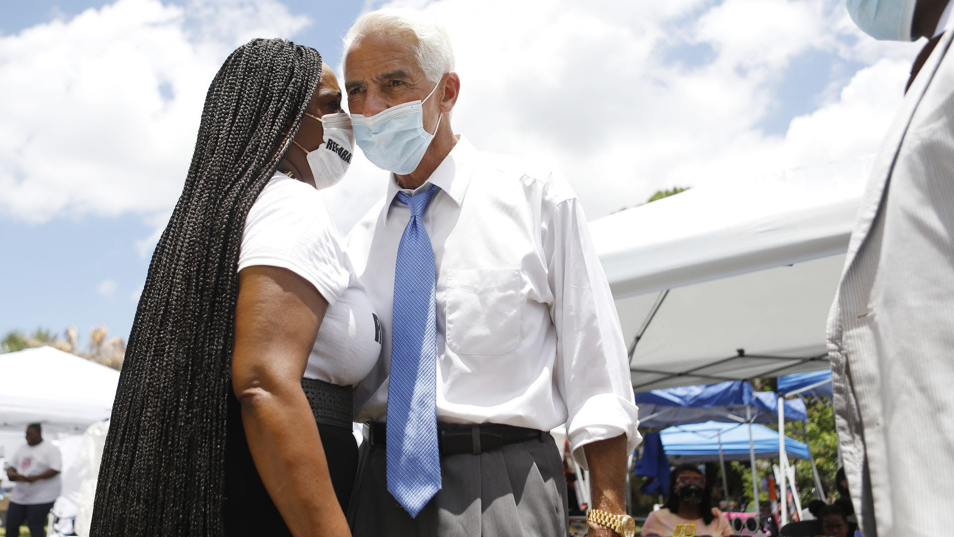Joyce Ward talks with Rep. Charlie Crist (D-FL) at her vendor booth during the Black Lives Matters Business Expo