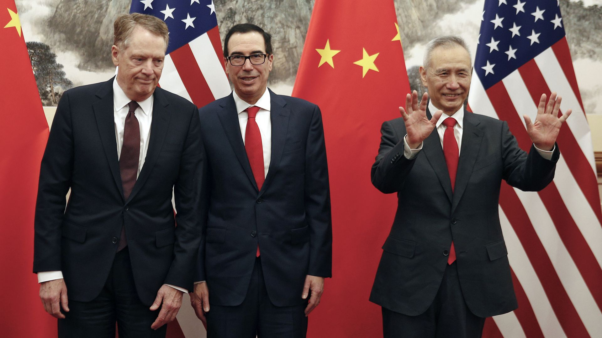 Chinese Vice Premier Liu He (R) gestures as US Treasury Secretary Steven Mnuchin (C) chats with his Trade Representative Robert Lighthizer.