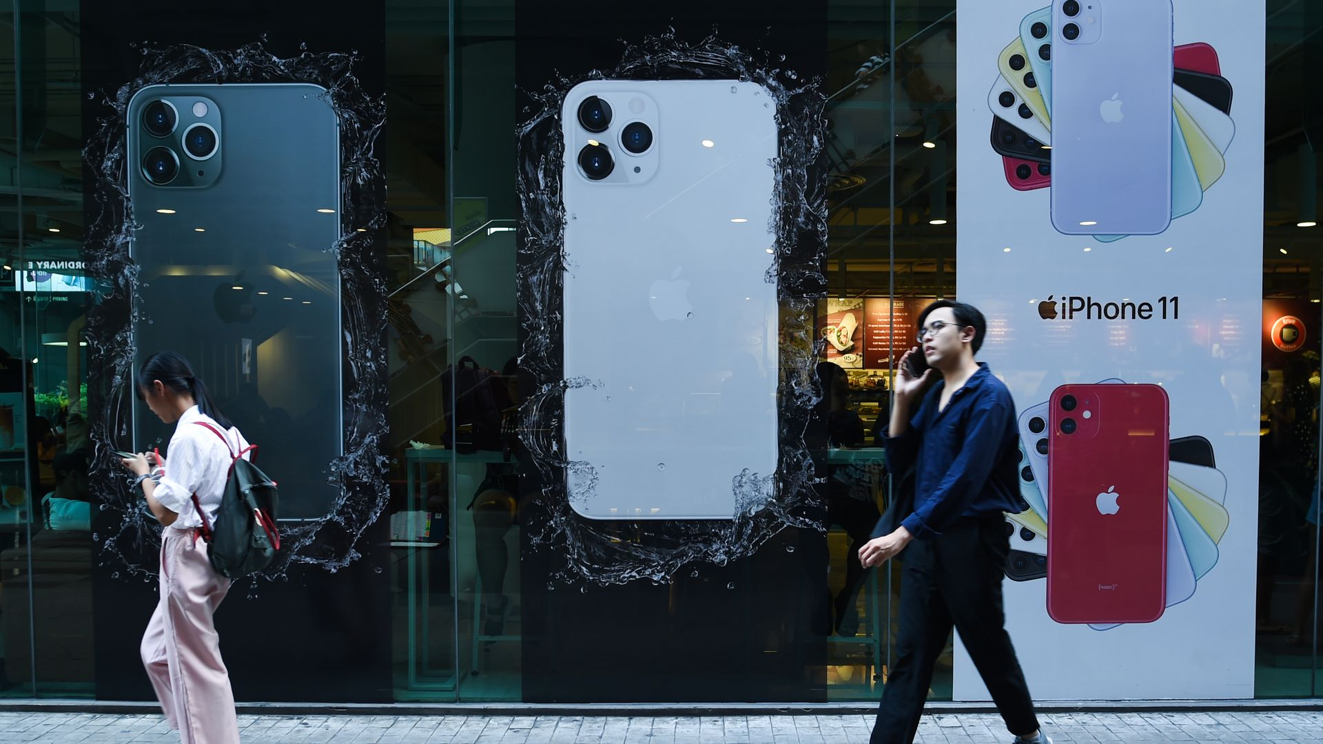 Ads for the iPhone 11 at a storefront