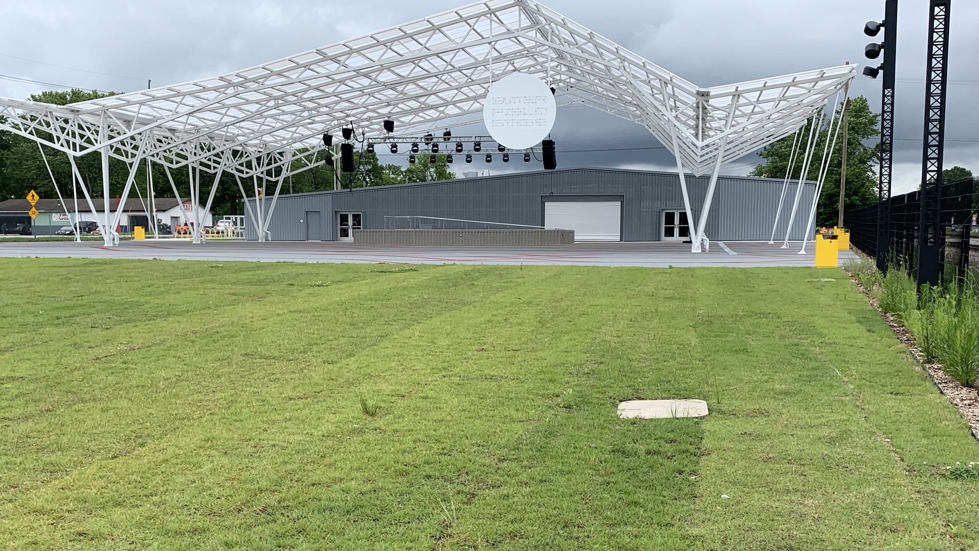 The new outdoor Butterfield Stage in Rogers is surrounded by grass