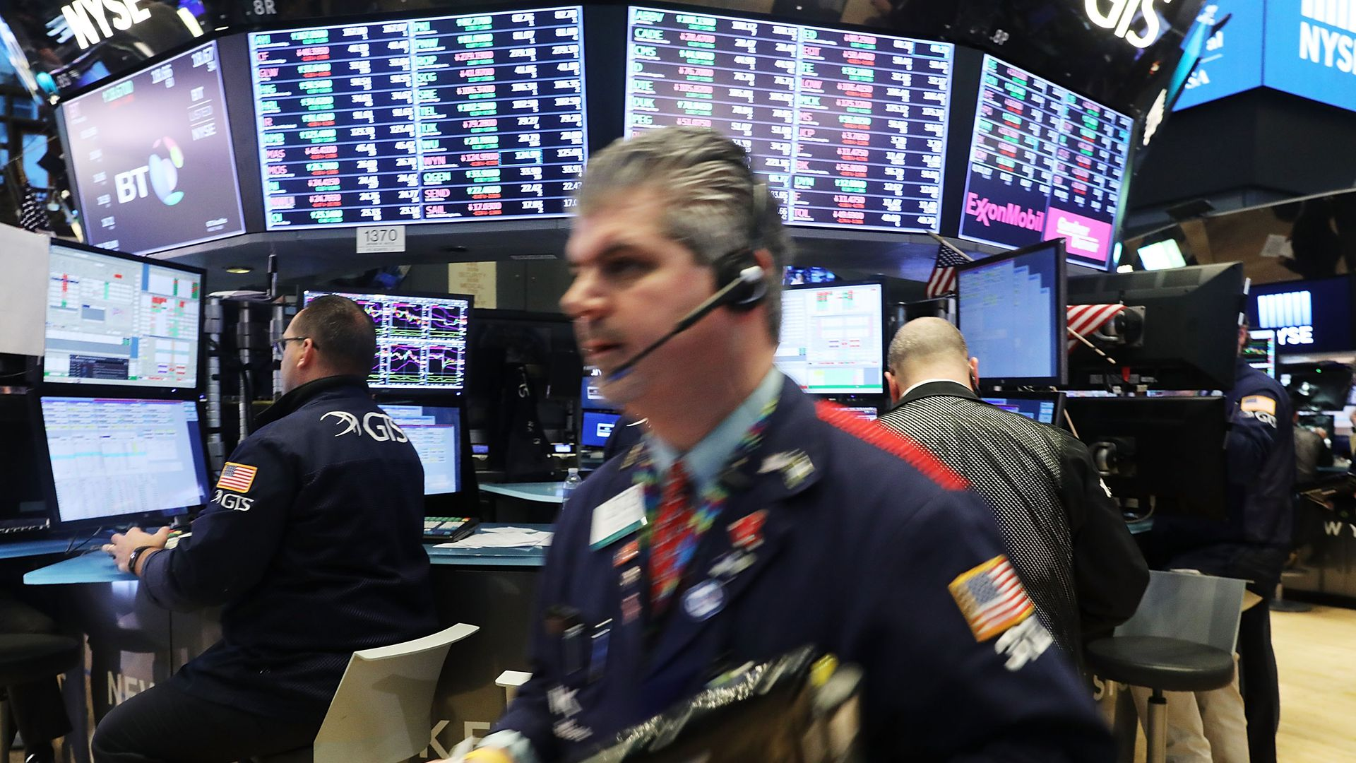 Brokers run around on the Wall Street stock exchange floor
