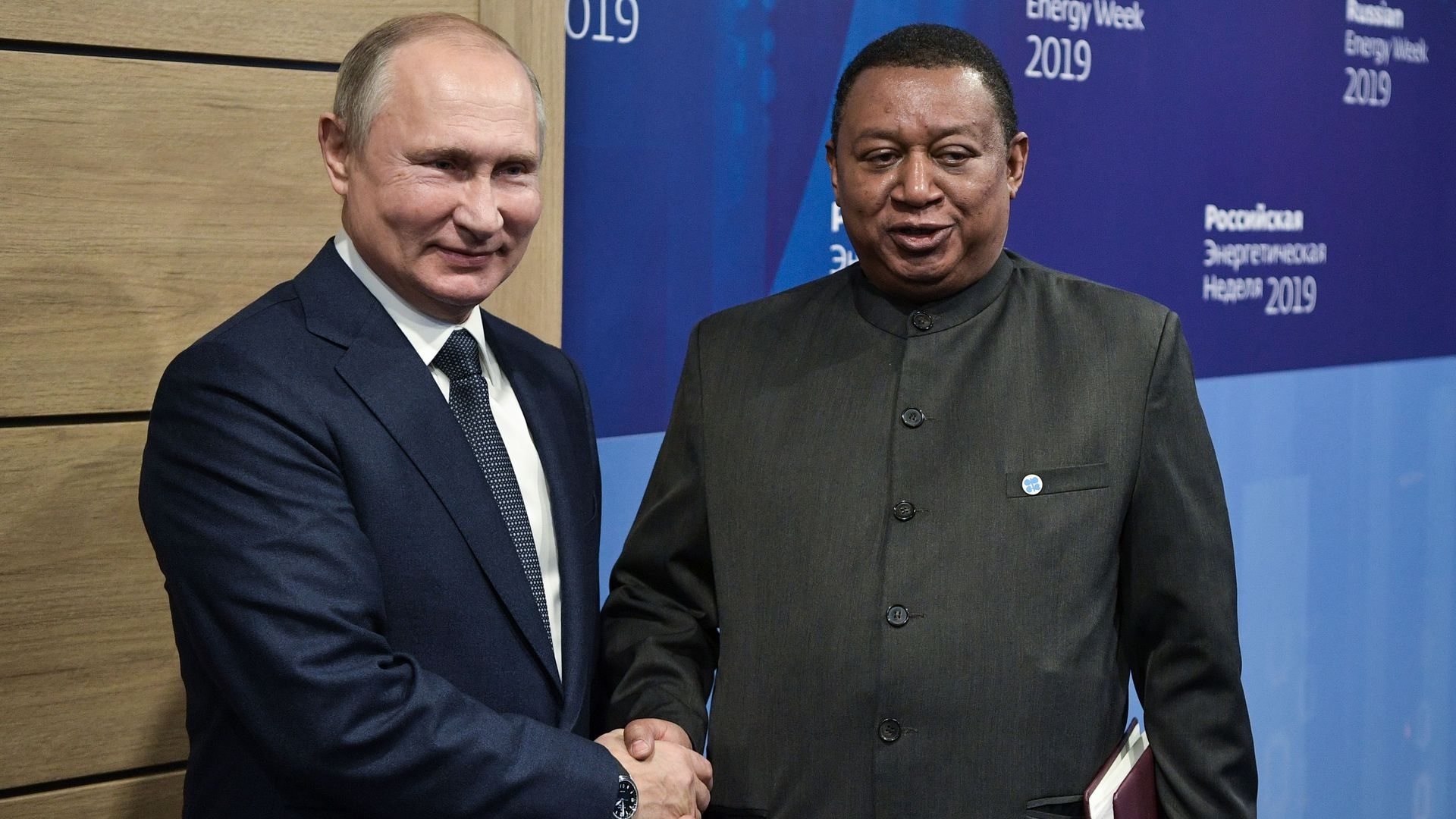 OPEC Secretary General Mohammed Barkindo (R) shakes hands with Russian President Vladimir Putin (L) during their meeting on the sidelines of the 2019 Russian Energy Week forum in Moscow, on October 2,