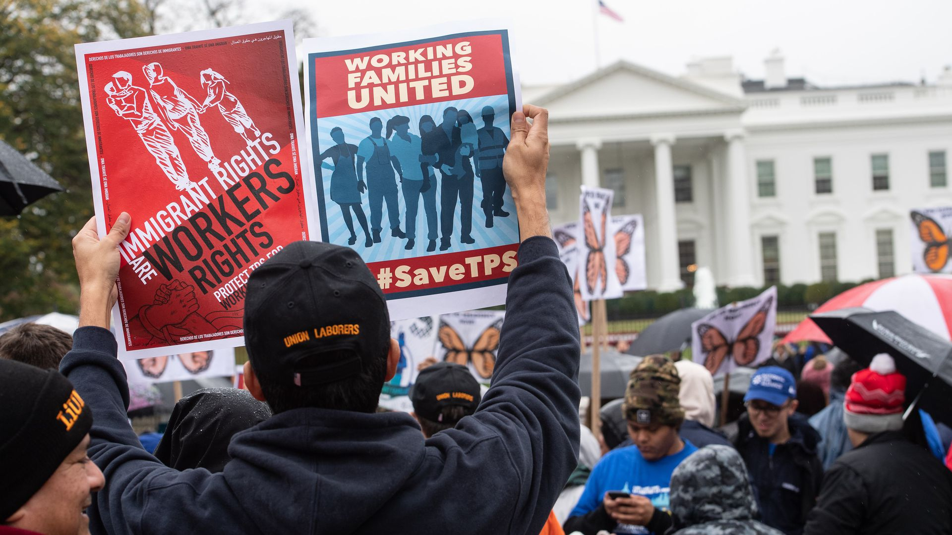 Demonstrators outside the White House protesting against the decision by the administration to terminate TPS for people from Sudan, El Salvador, Haiti and Nicaragua.