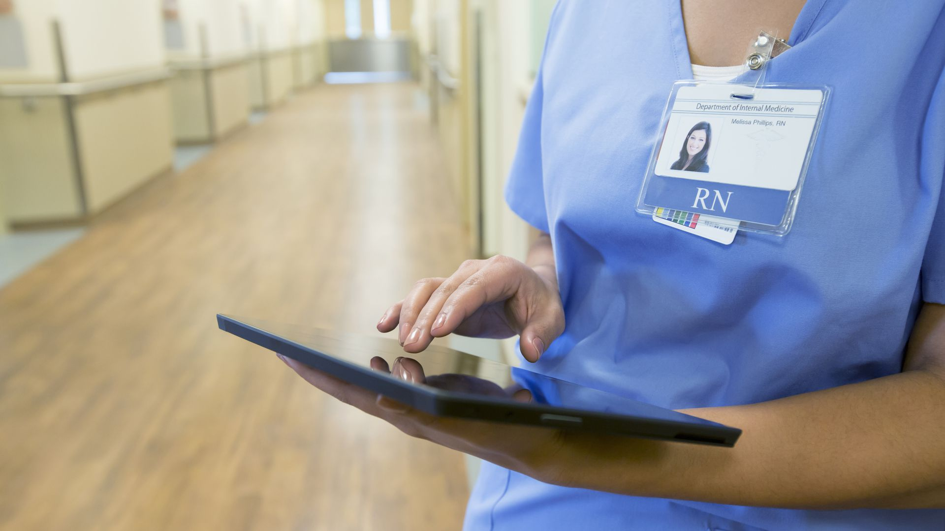 Nurse using tablet device