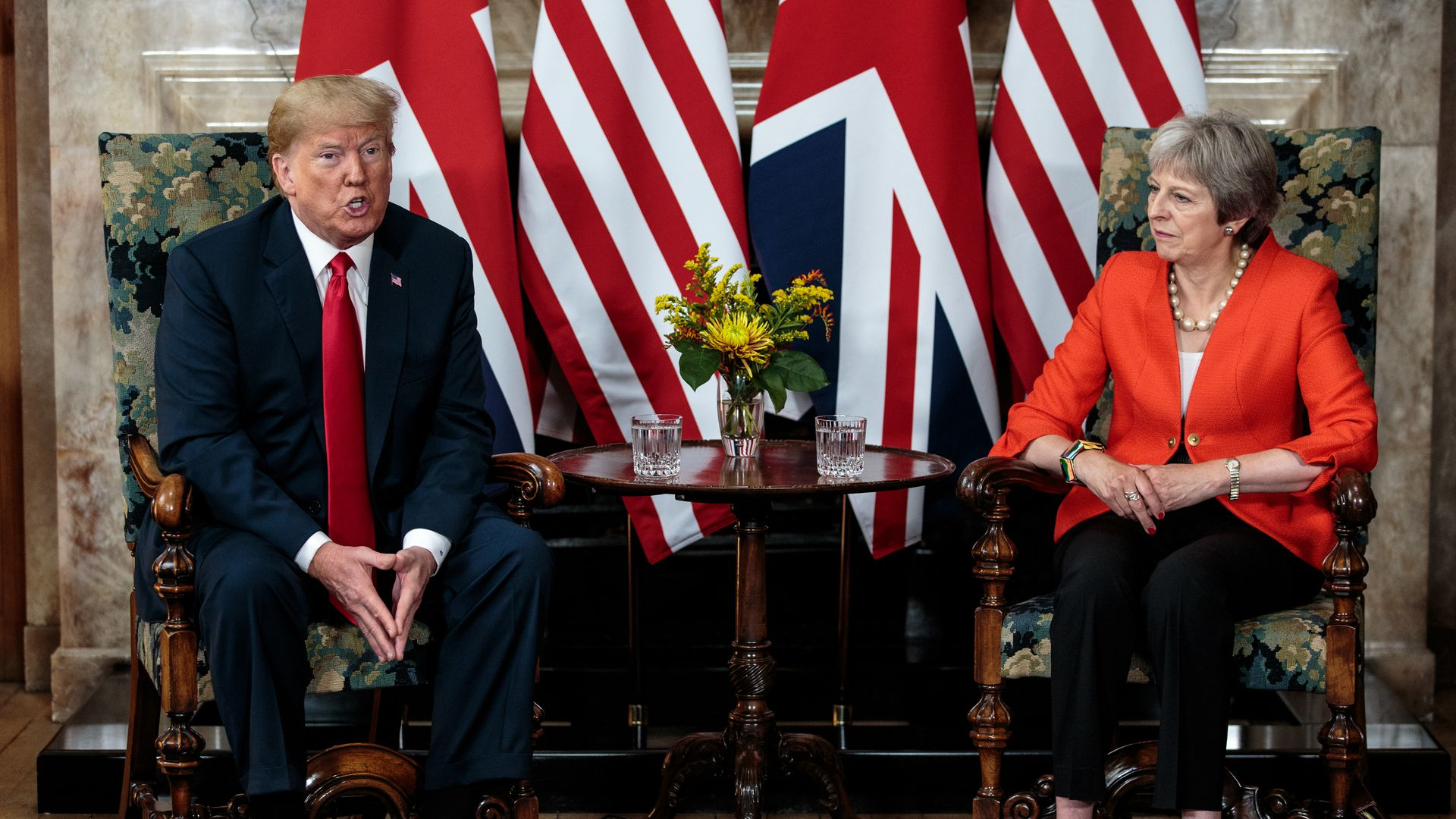Trump and Theresa May sit together for a press conference