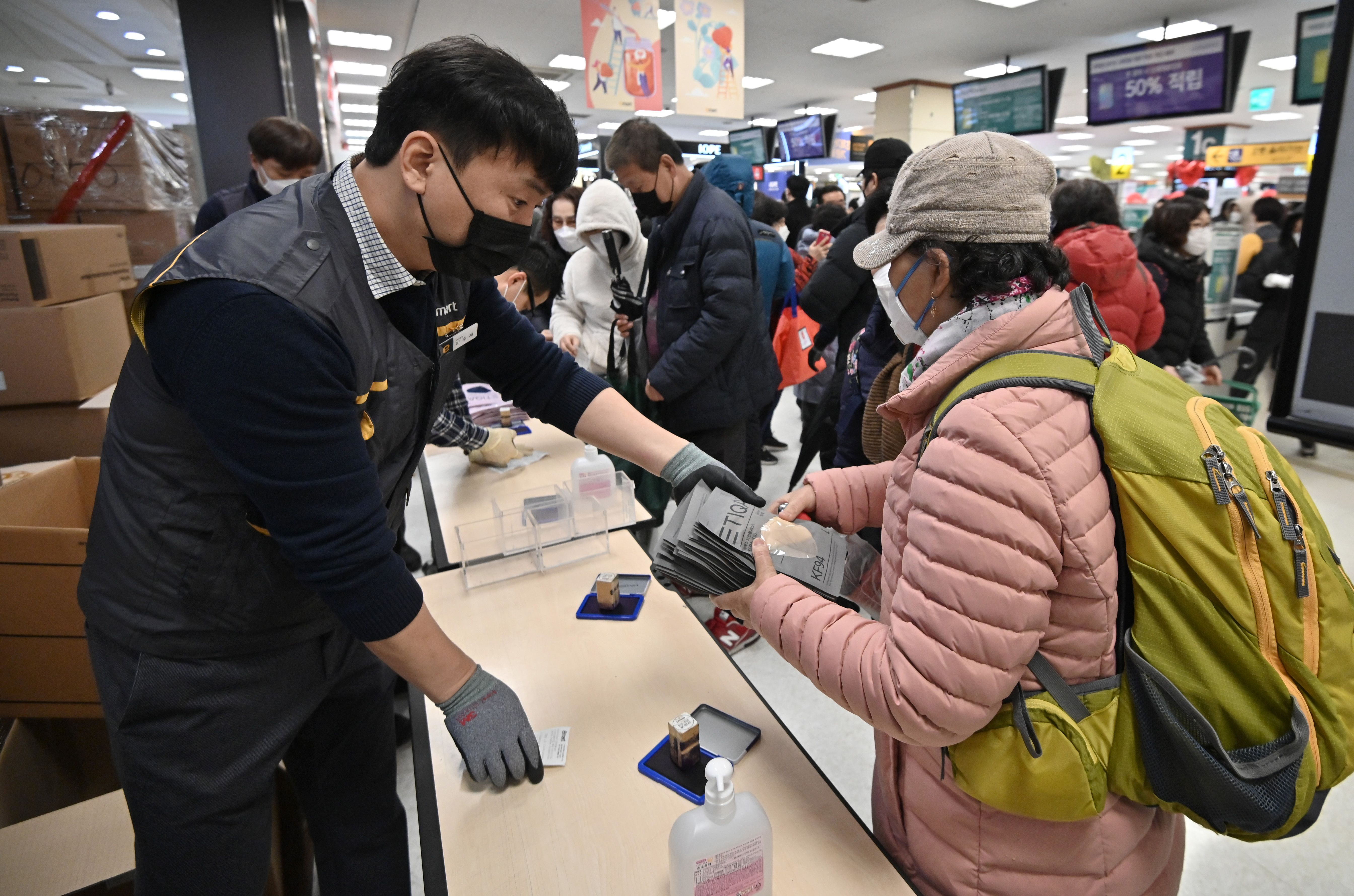 People buy face masks at a retail store in the southeastern city of Daegu on February 25