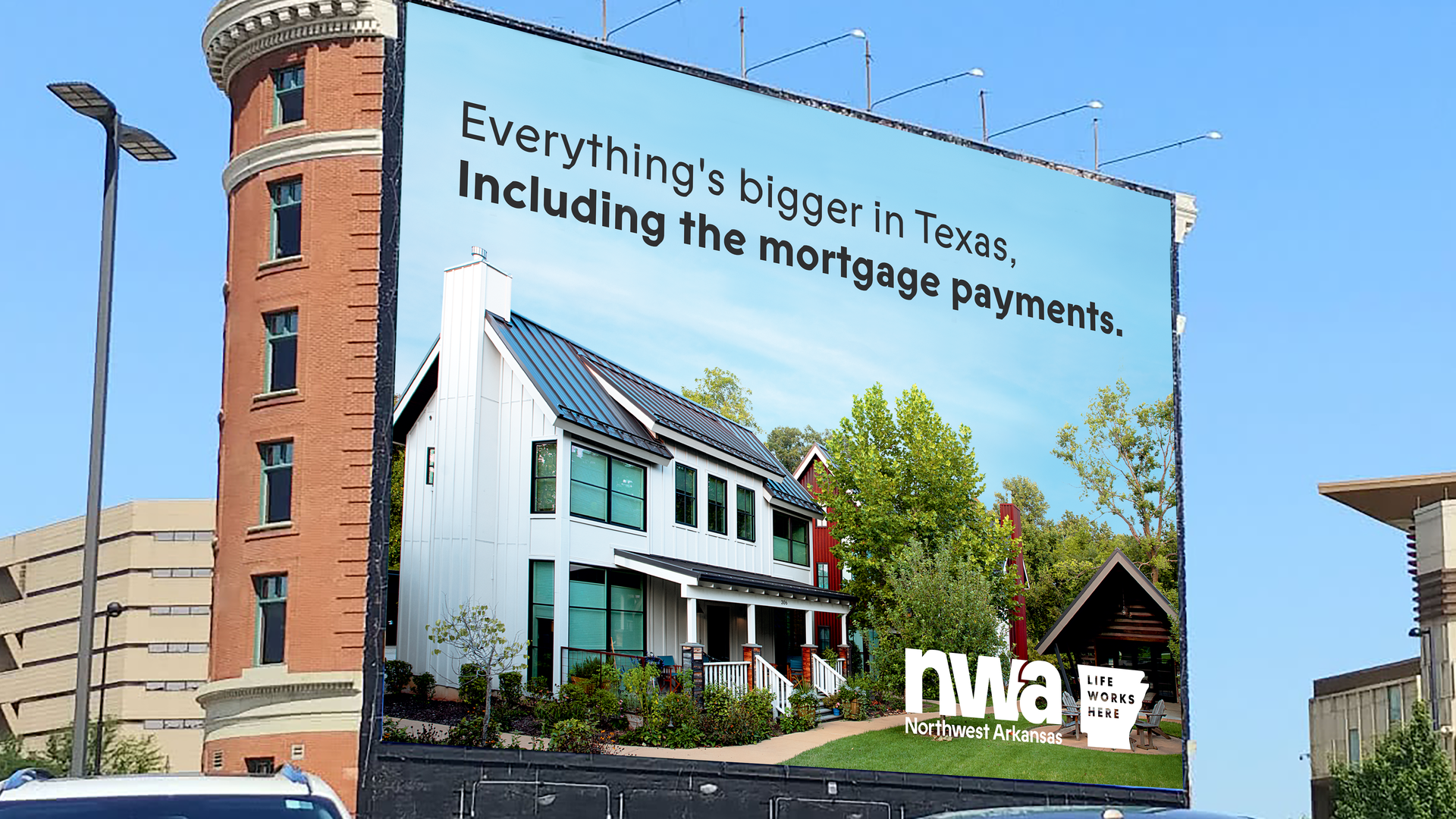 A billboard that reads Everything's bigger in Texas, including the mortgage payments.