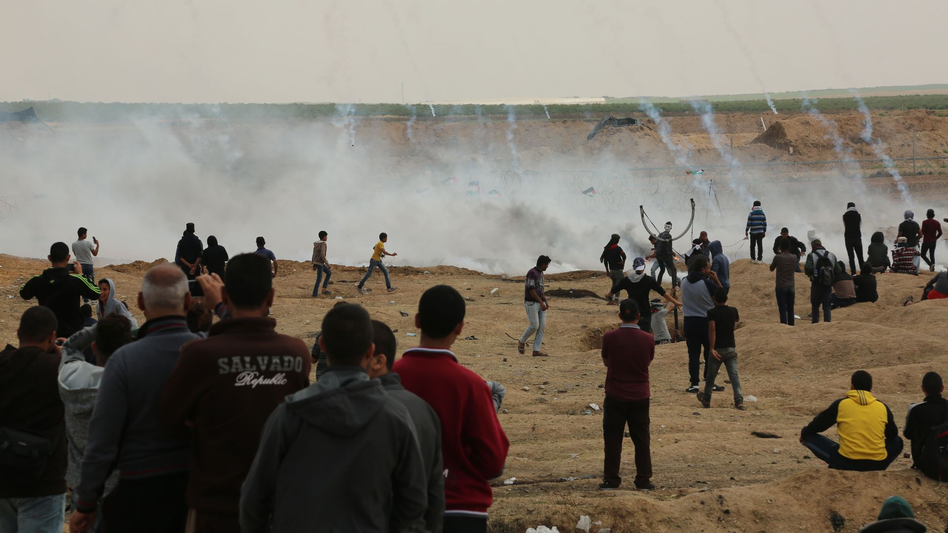Tear gas canisters are fired by Israeli troops at Palestinian demonstrators on Friday.