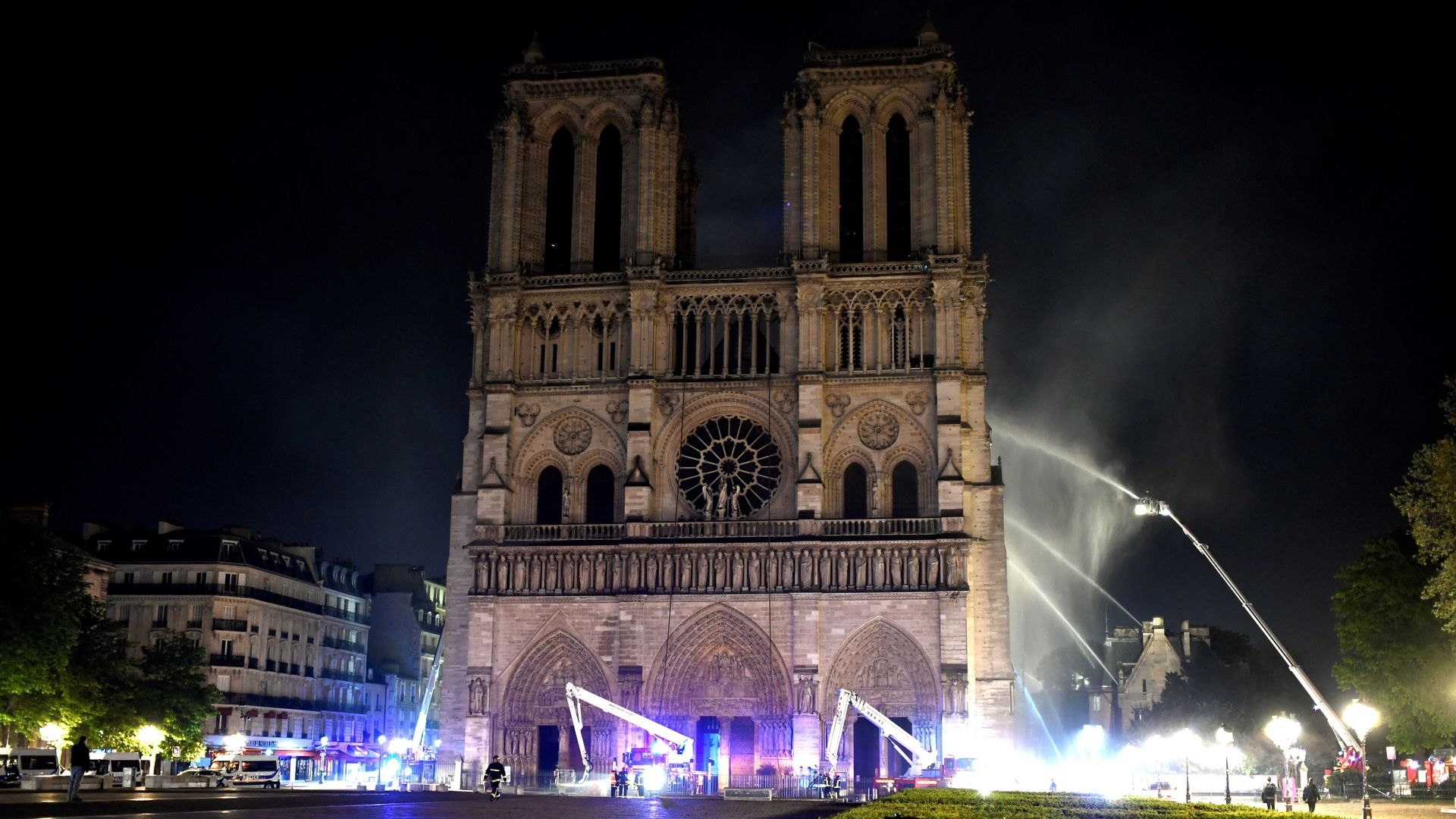 Firefighters douse flames at Notre Dame Cathedral in Paris.