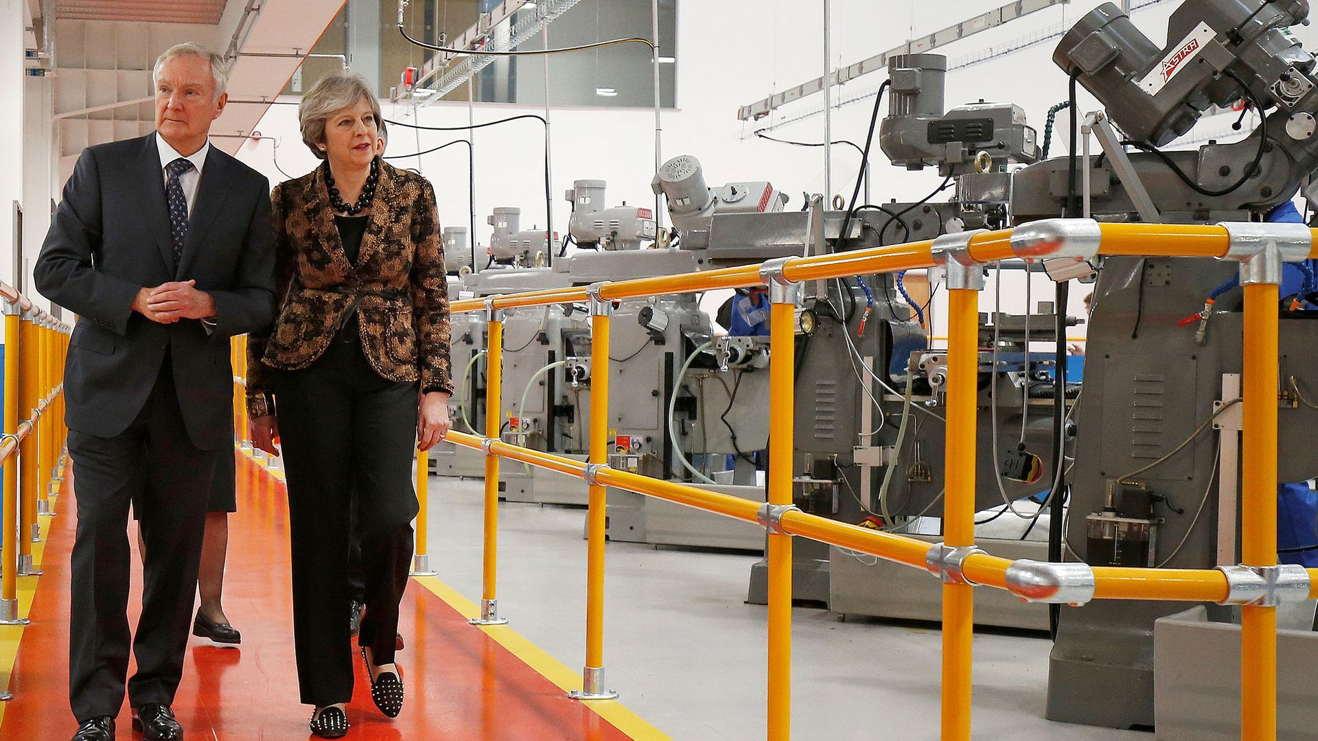 Theresa May visits an engineering facility.