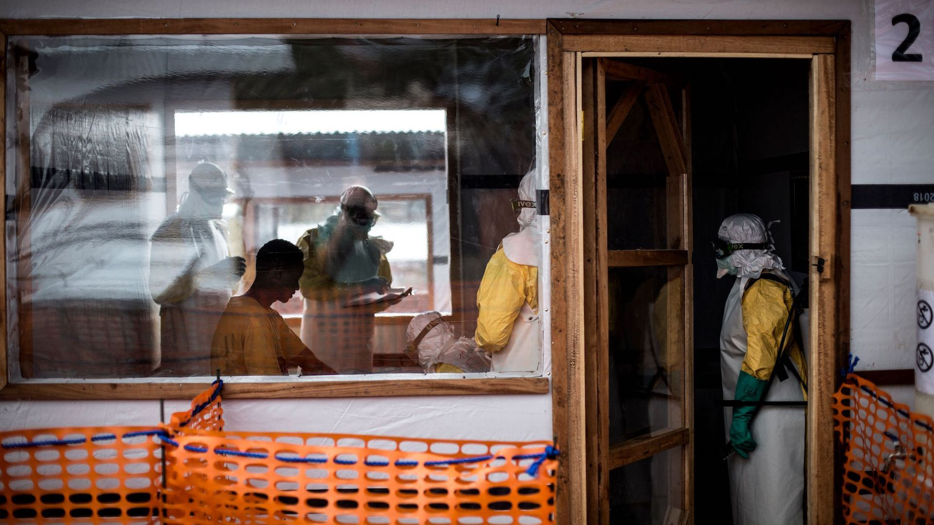 Doctors treating a patient at an Ebola treatment unit