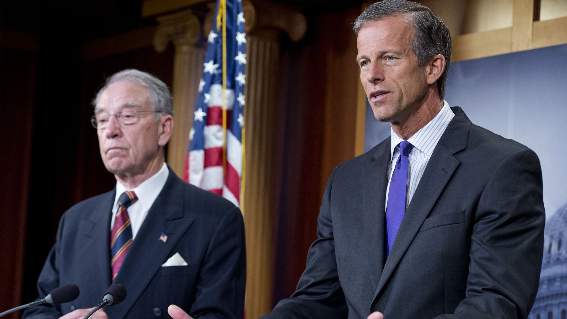 Senators Chuck Grassley and John Thune at the press conference, with an American flag behind them