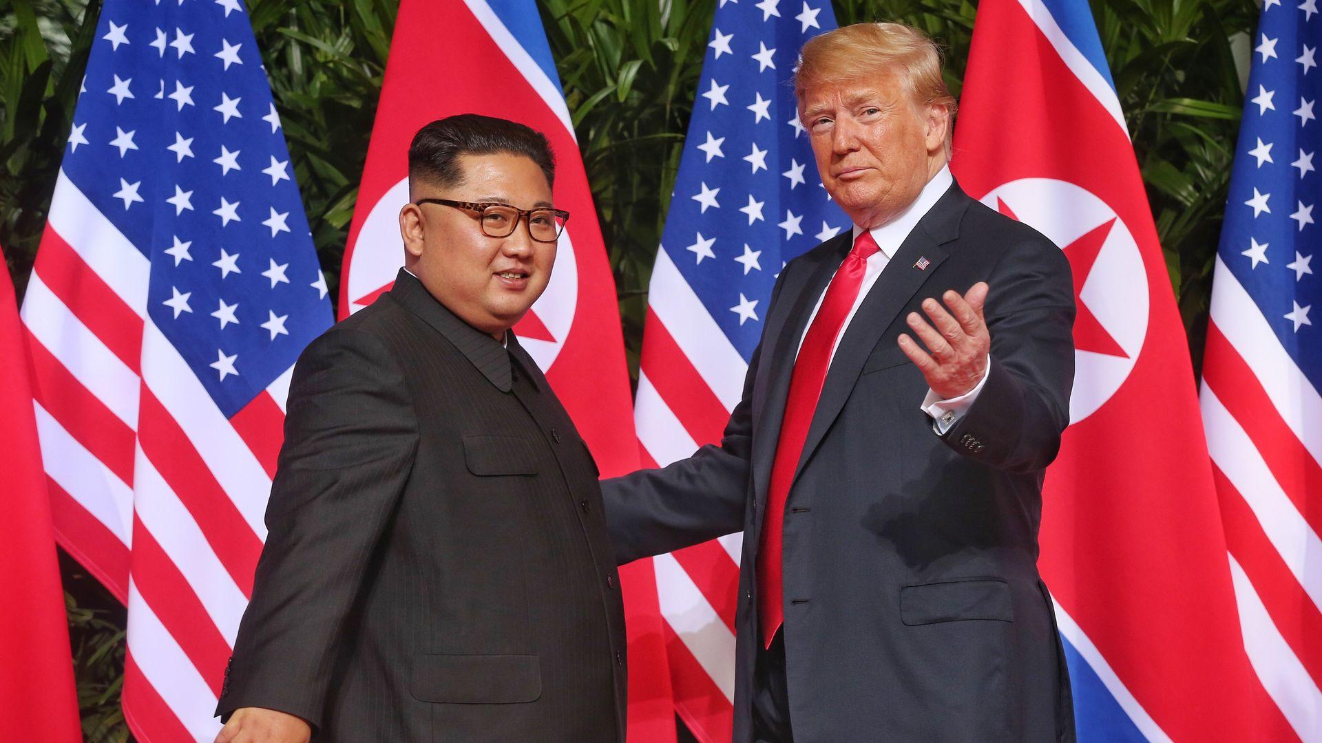 Trump greets Kim Jong-un in Singapore