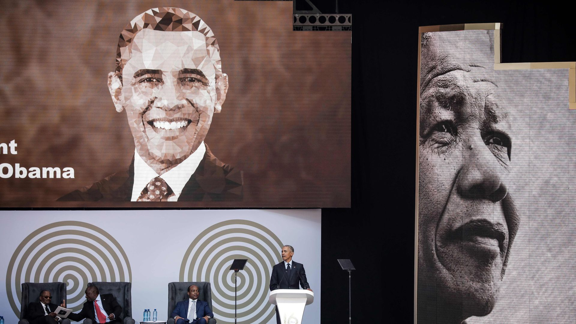 Obama giving a speech on Mandela's 100th birthday